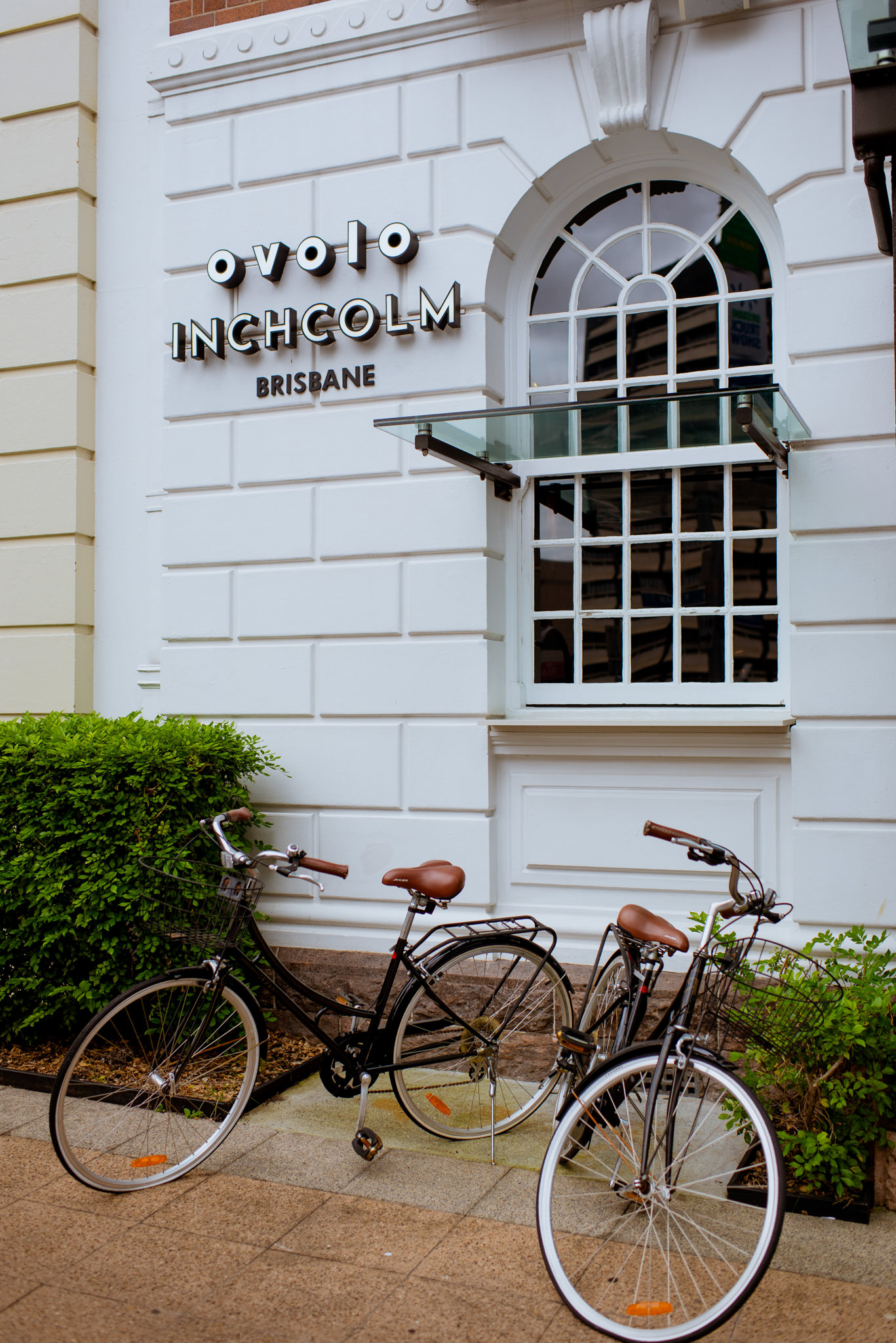 Two bicycles parked outside Ovolo Incholm Hotel, Brisbane