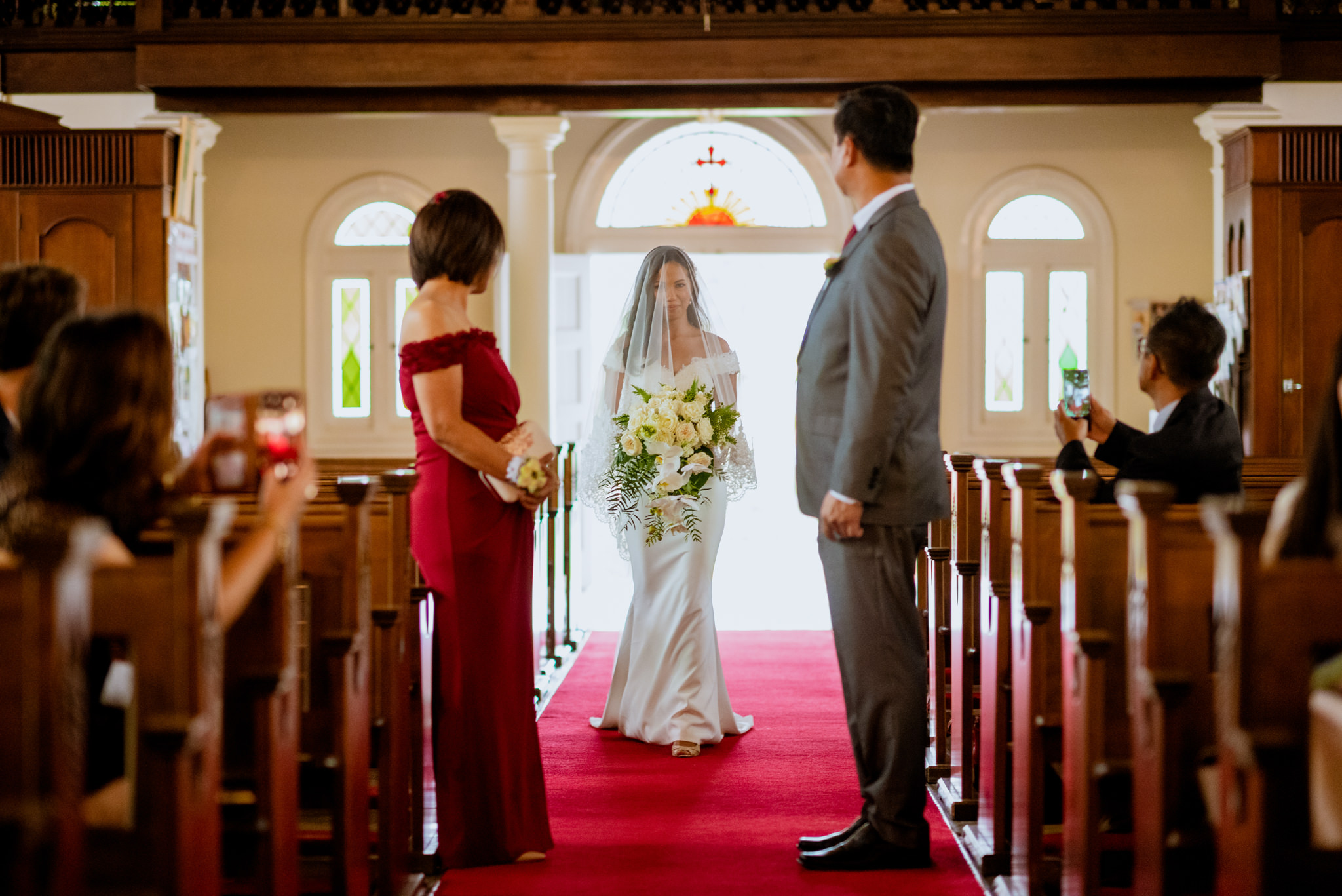 Bride walks down church aisle as her parents wait for her halfway