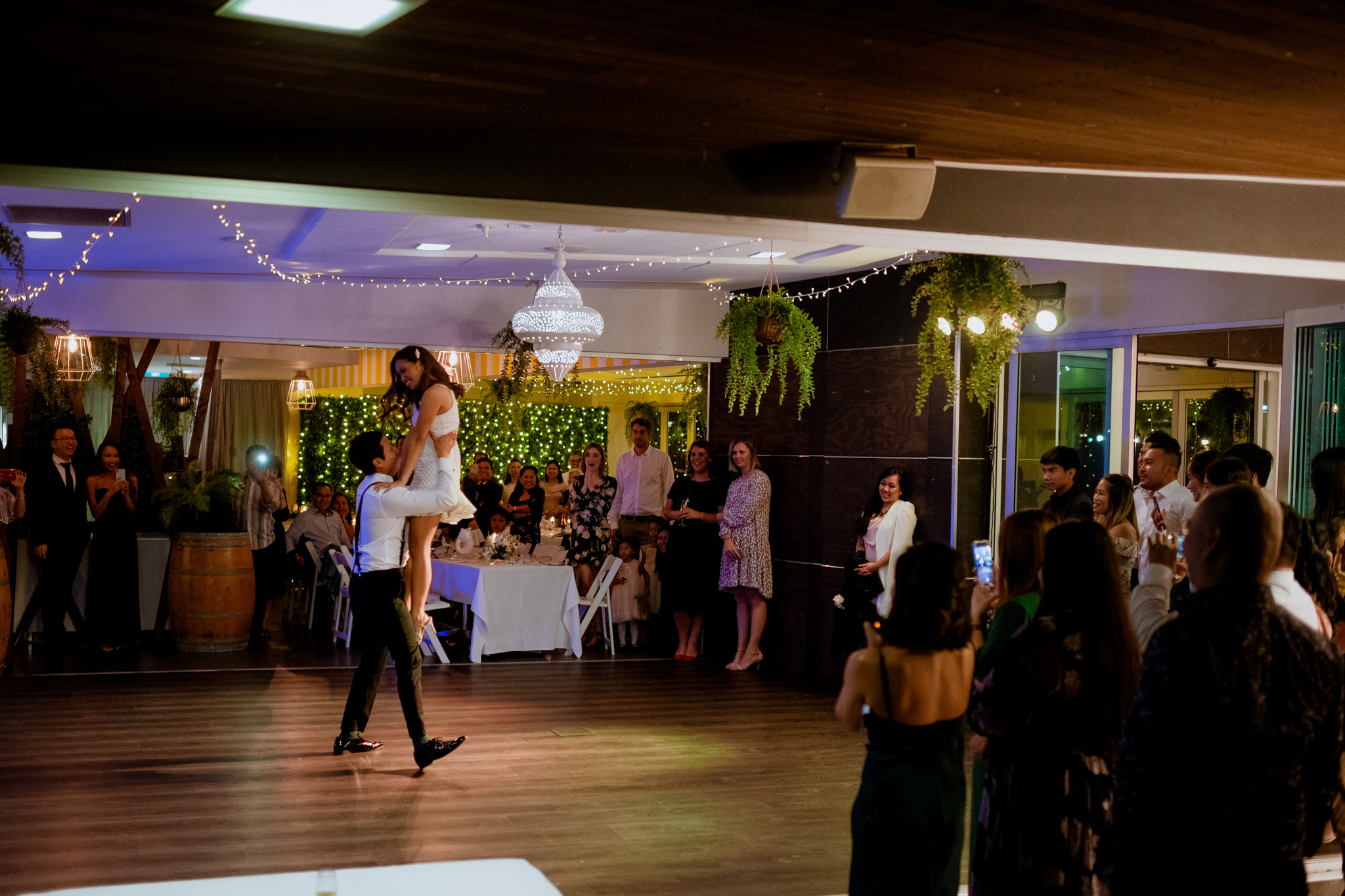 A newlywed couple performs a dance at Northshore Harbour, Brisbane