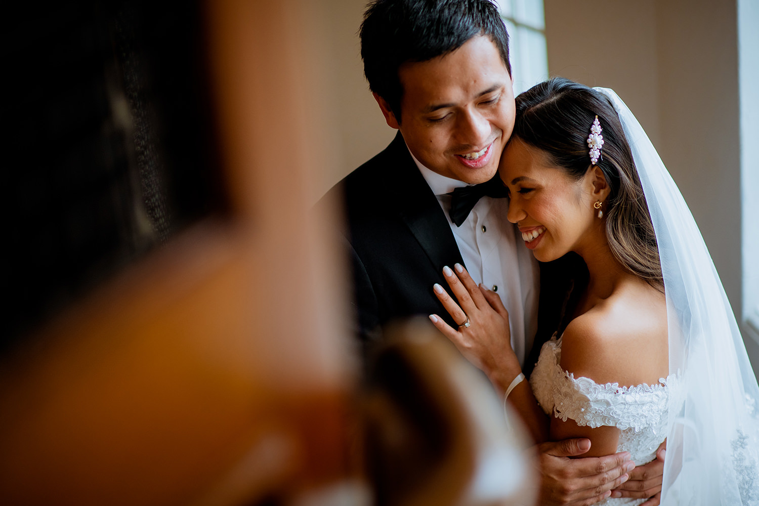 Happy bride and groom hugging in Ovolo Incholm