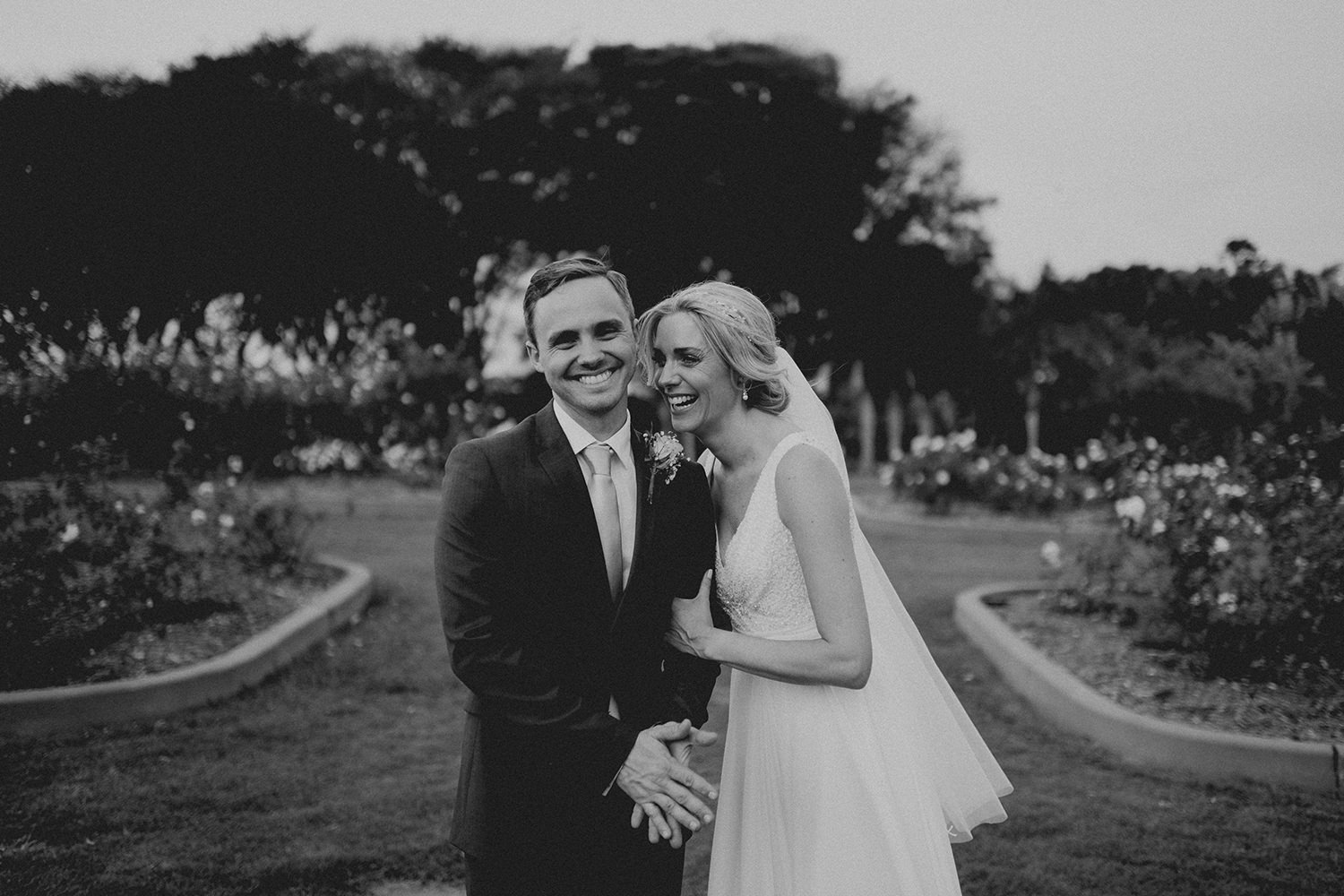 Happy bride and groom in New Farm Park, Brisbane