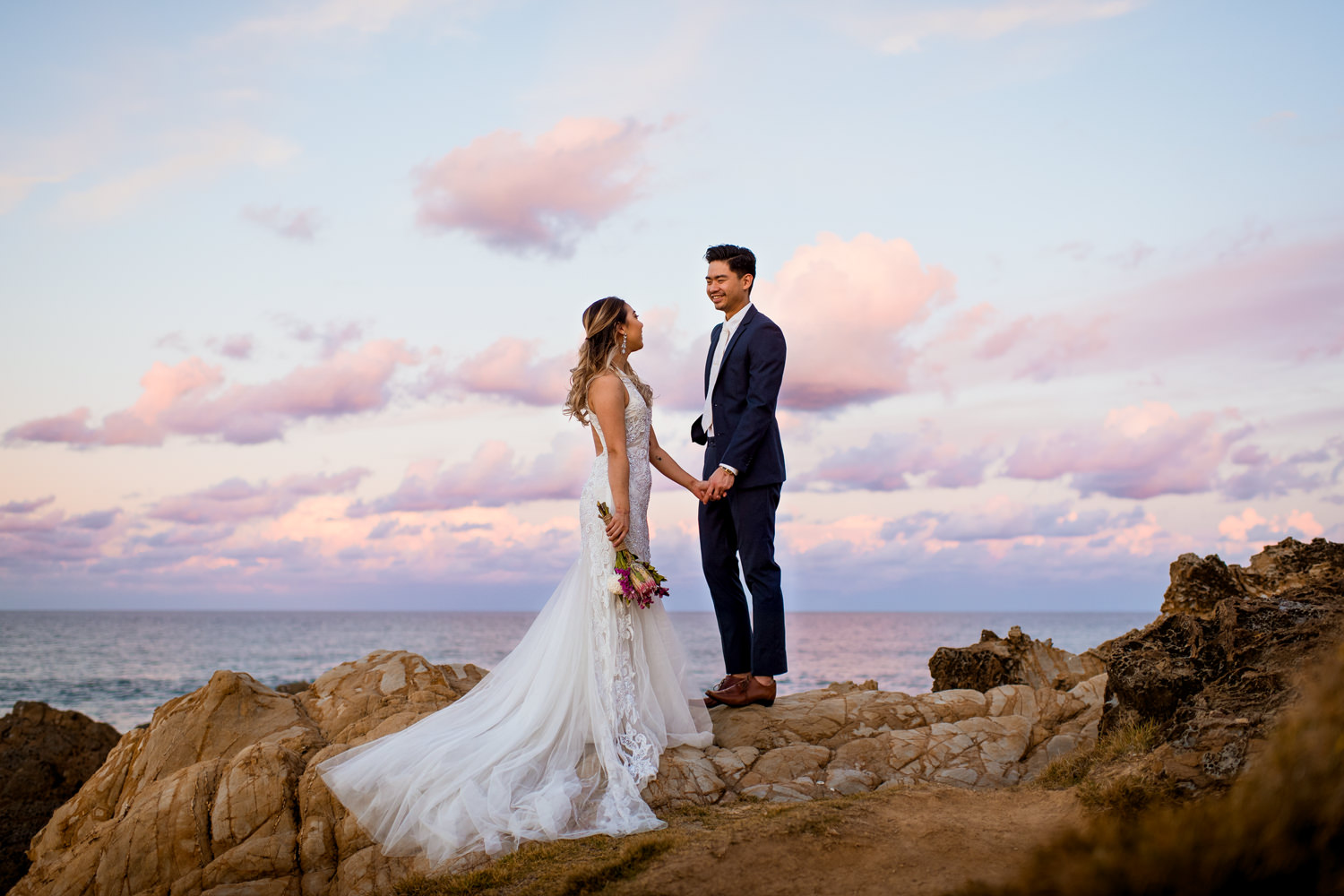 Asian bride and groom posing at Byron Bay