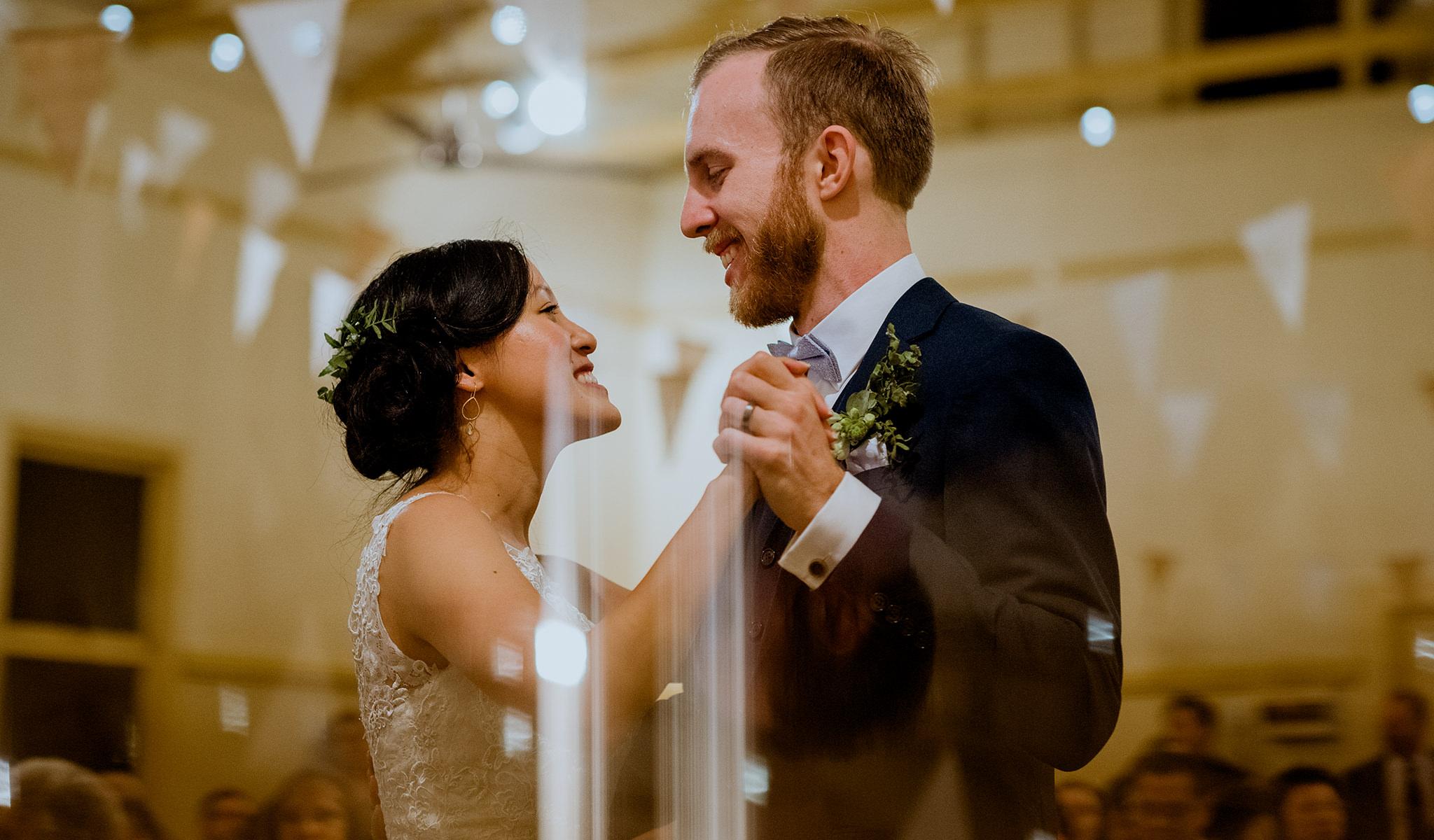 Interracial bride and groom enjoying first dance