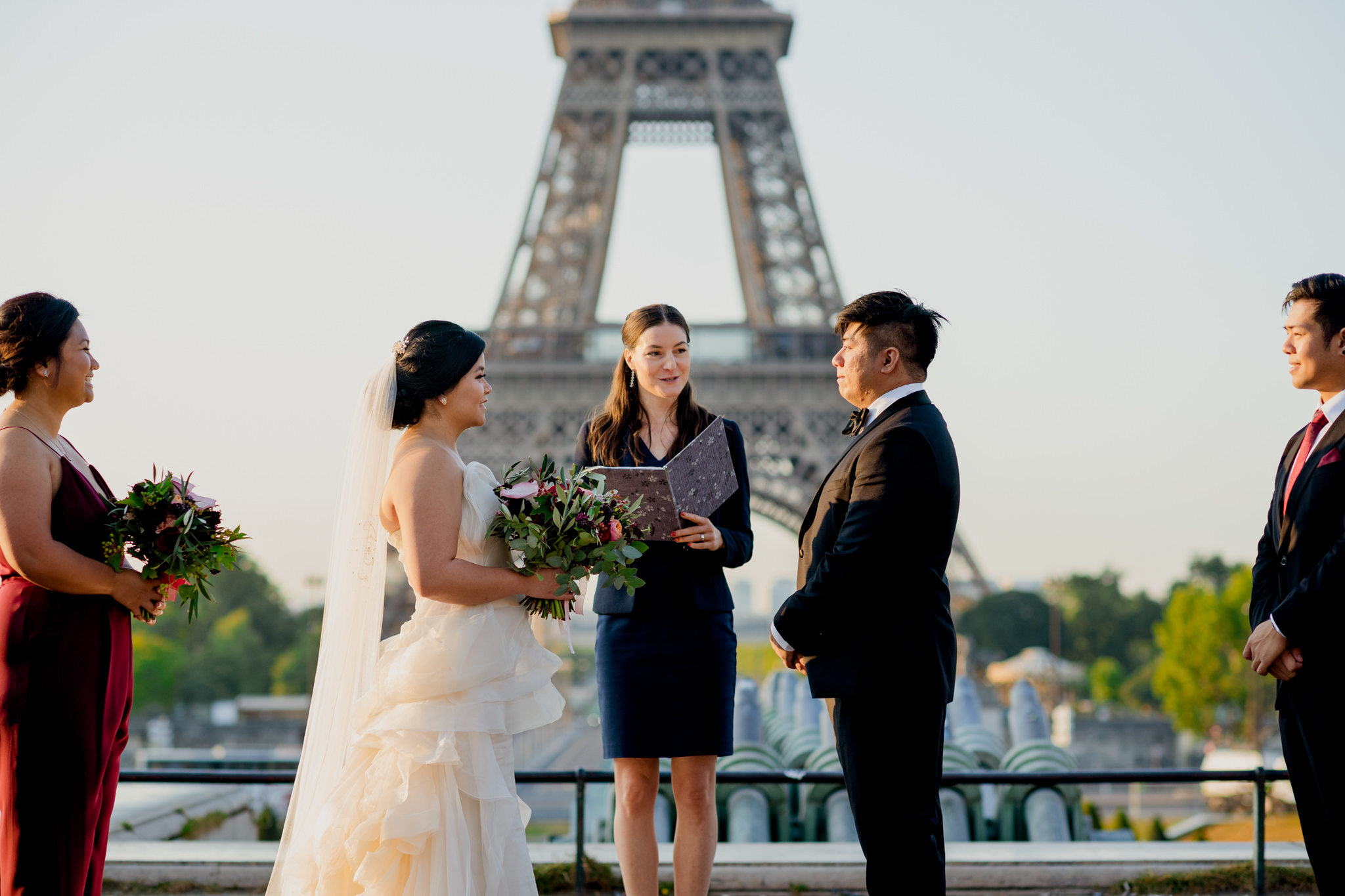 A bride and groom during a wedding ceremony in Paris.