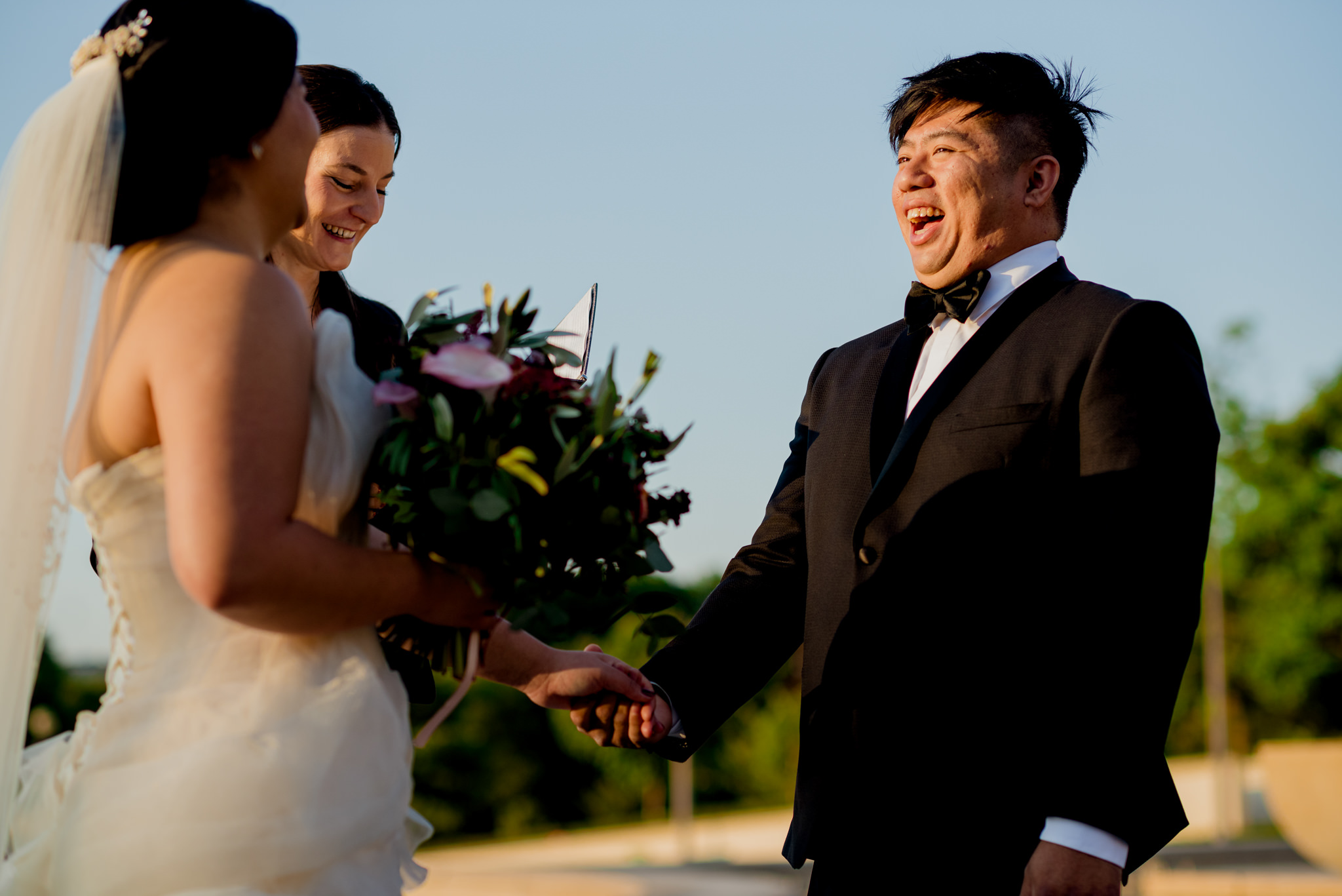 A groom laughs during his wedding ceremony.