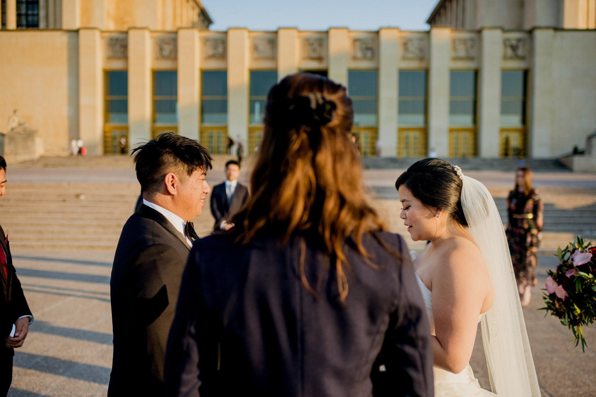 A bride recites her vows to her groom at their Palais De Chaillot wedding.