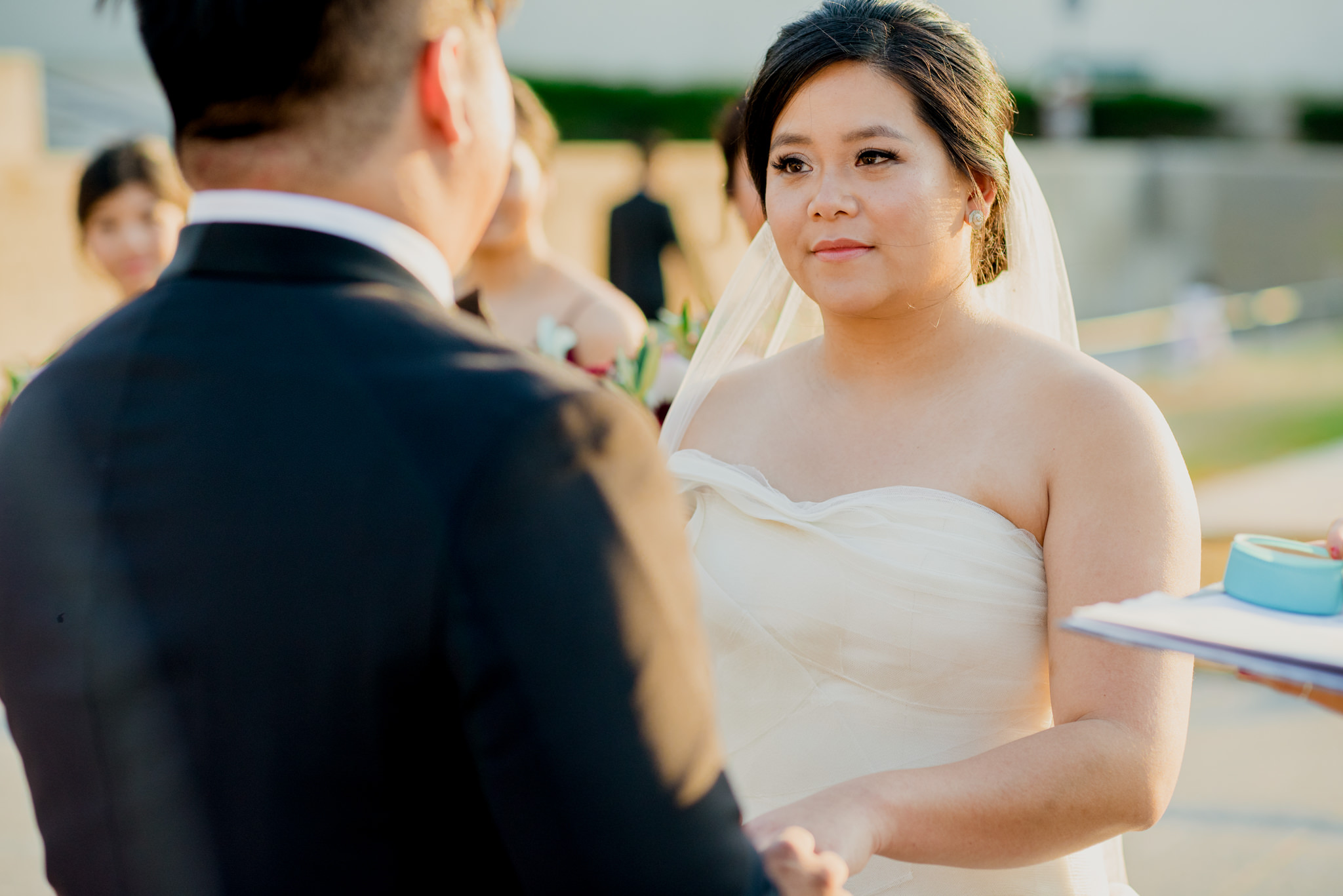 Asian bride looks lovingly at her groom.