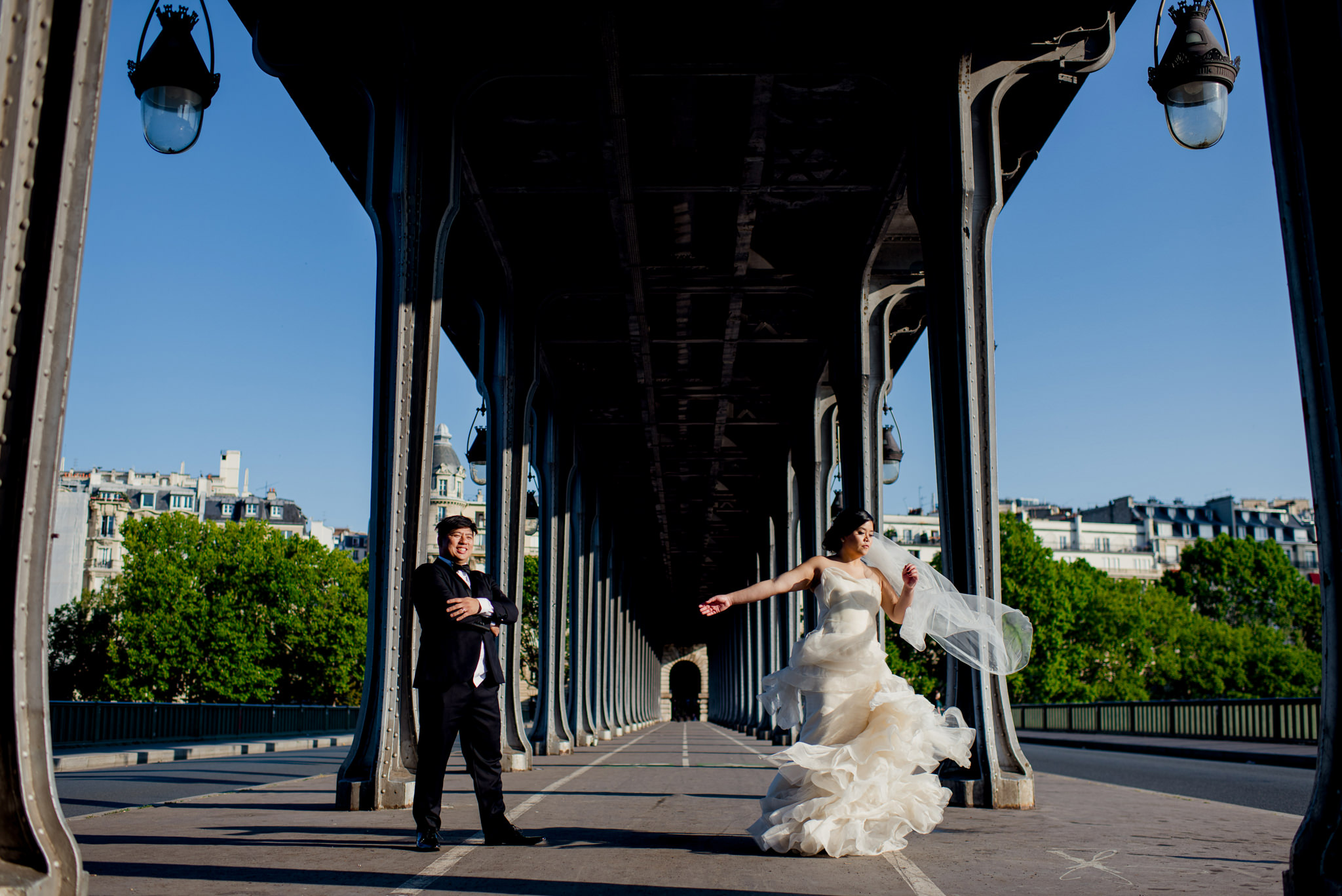 Bride twirls next to her groom on the Bir-Hakeim bride, Paris