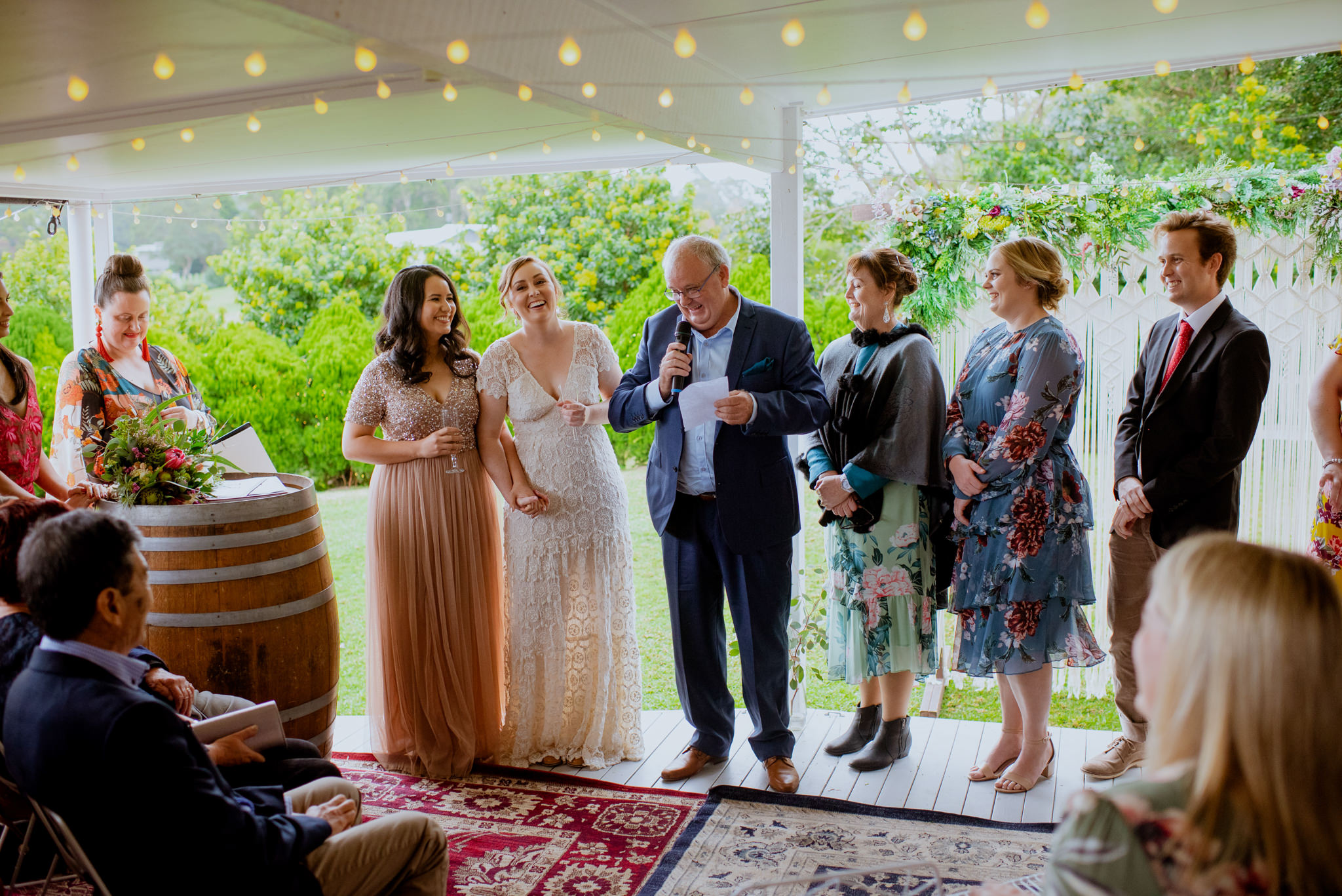 Same sex backyard Maleny wedding ceremony with father of the bride speaking at