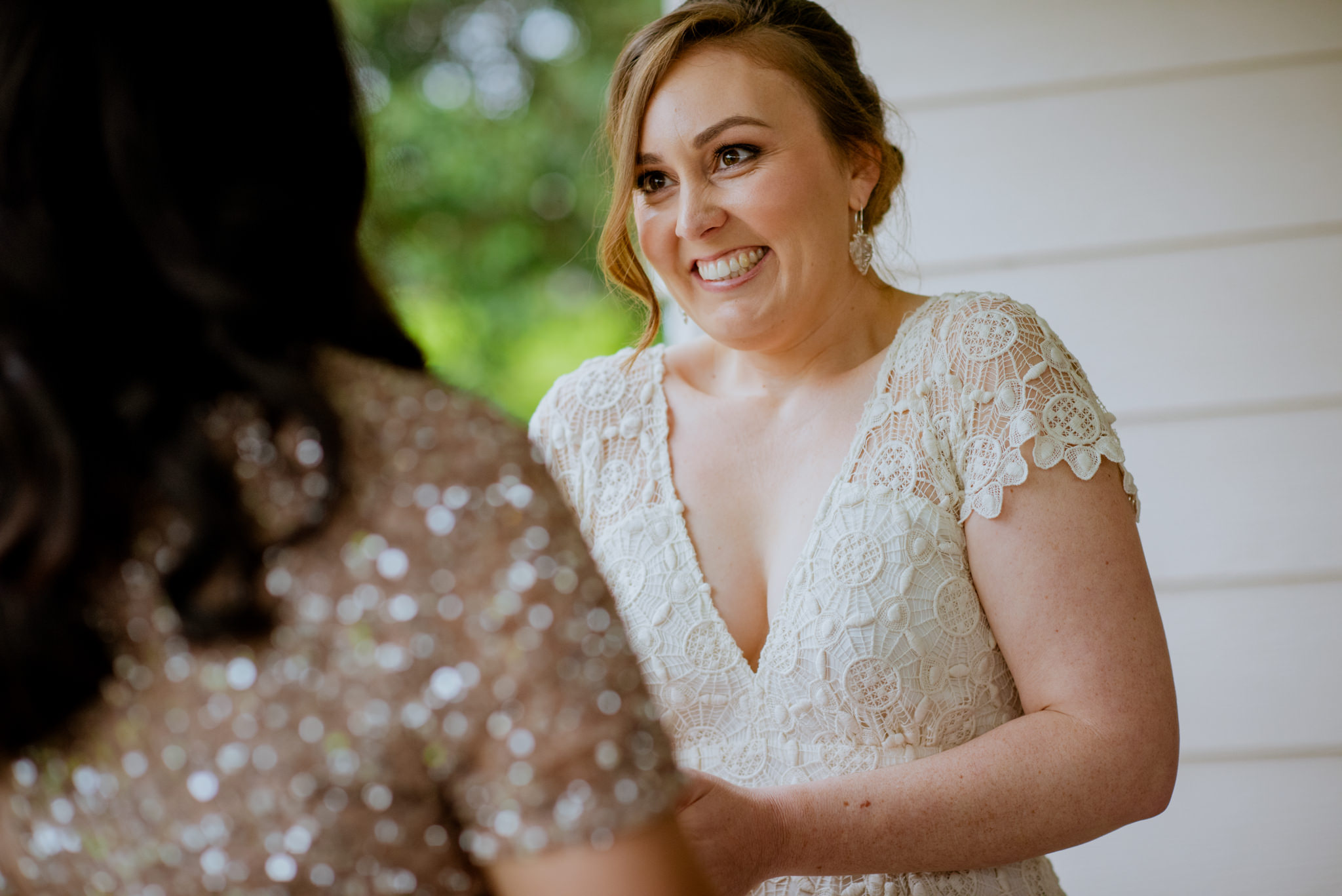 Nervous looking bride puts ring on her partner