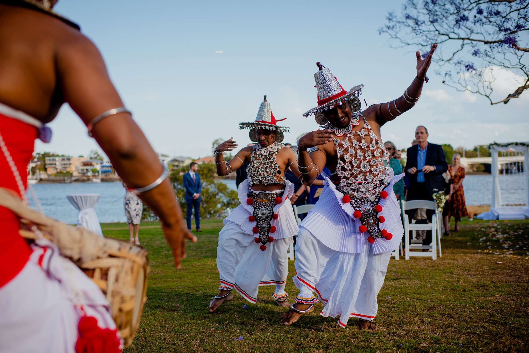 Traditional Sri-Lankan dancers dance at the beginning of an outdoor wedding ceremony