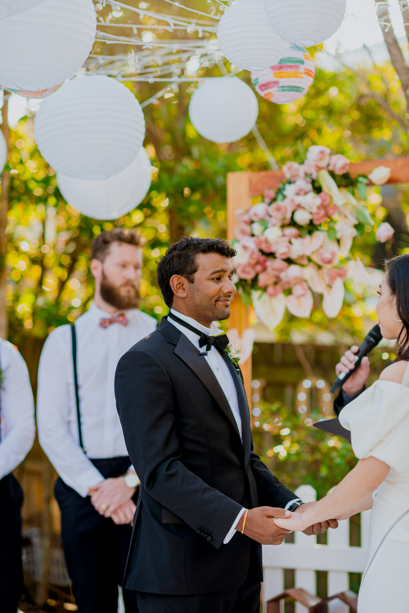 An Indian groom holds back tears during his garden wedding ceremony