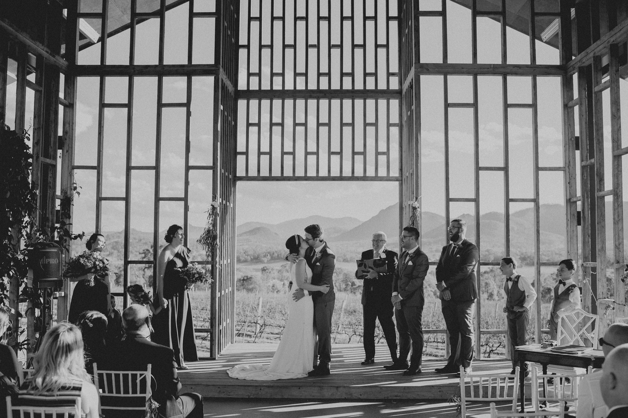 A bride and groom kiss in the chapel at Kooroomba Lavender Farm