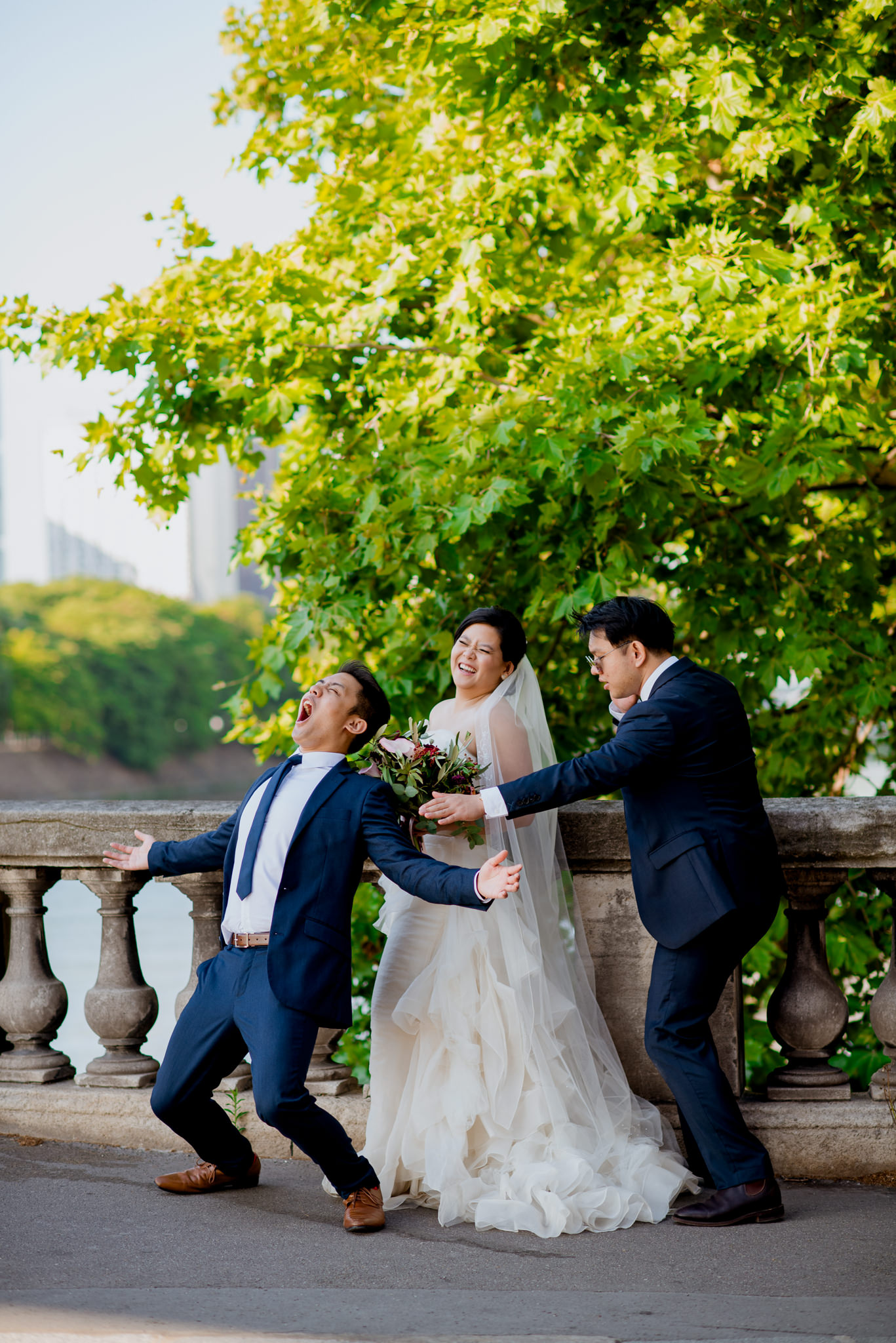 Two men in suits pretend to be bodyguards to a laughing bride
