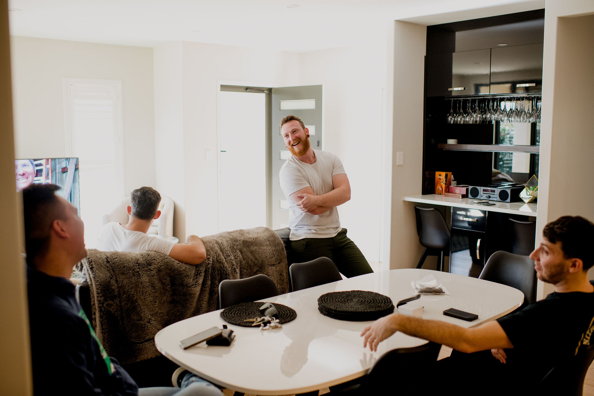Men laughing together in living room