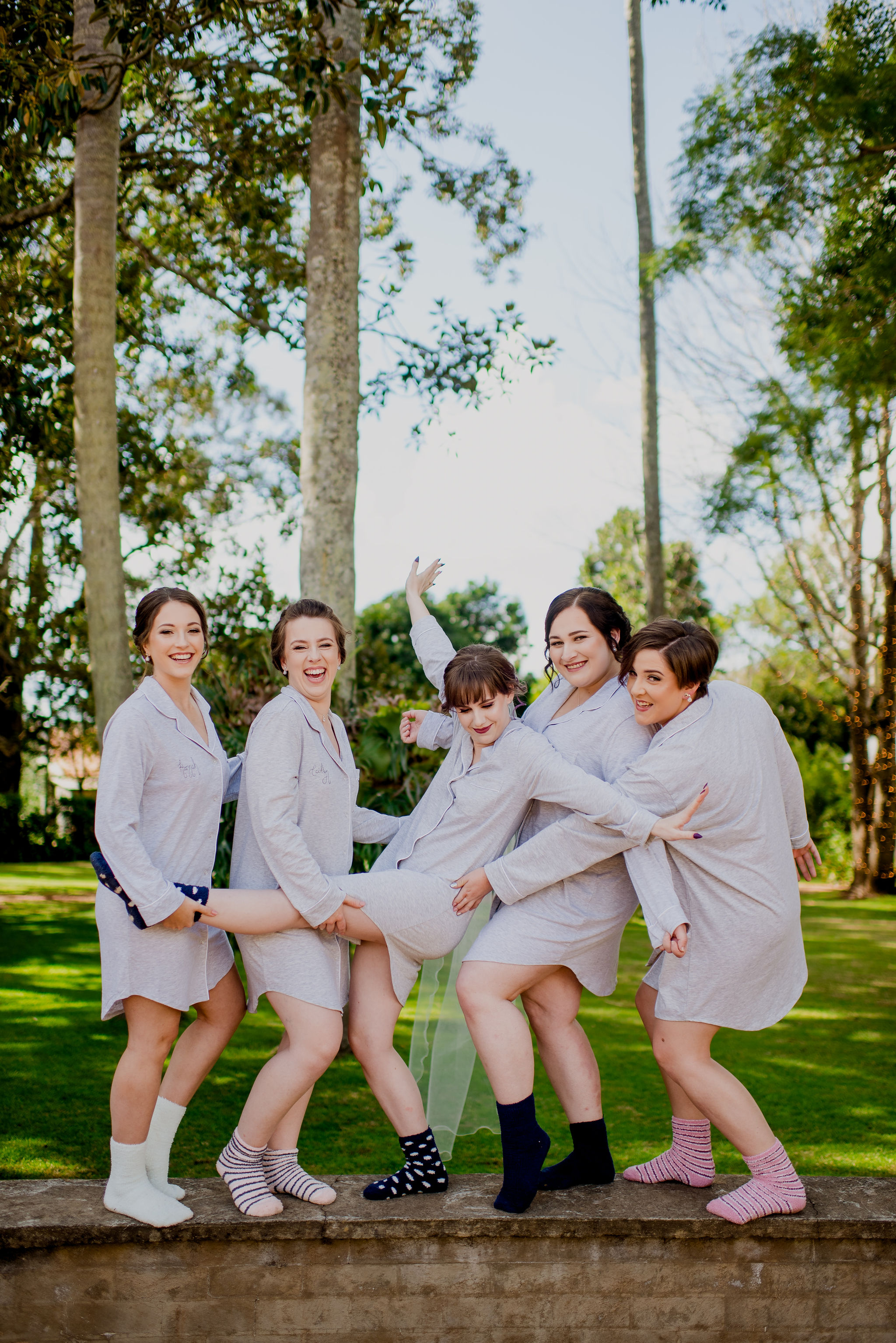 Bride-to-be and bridesmaids posing together