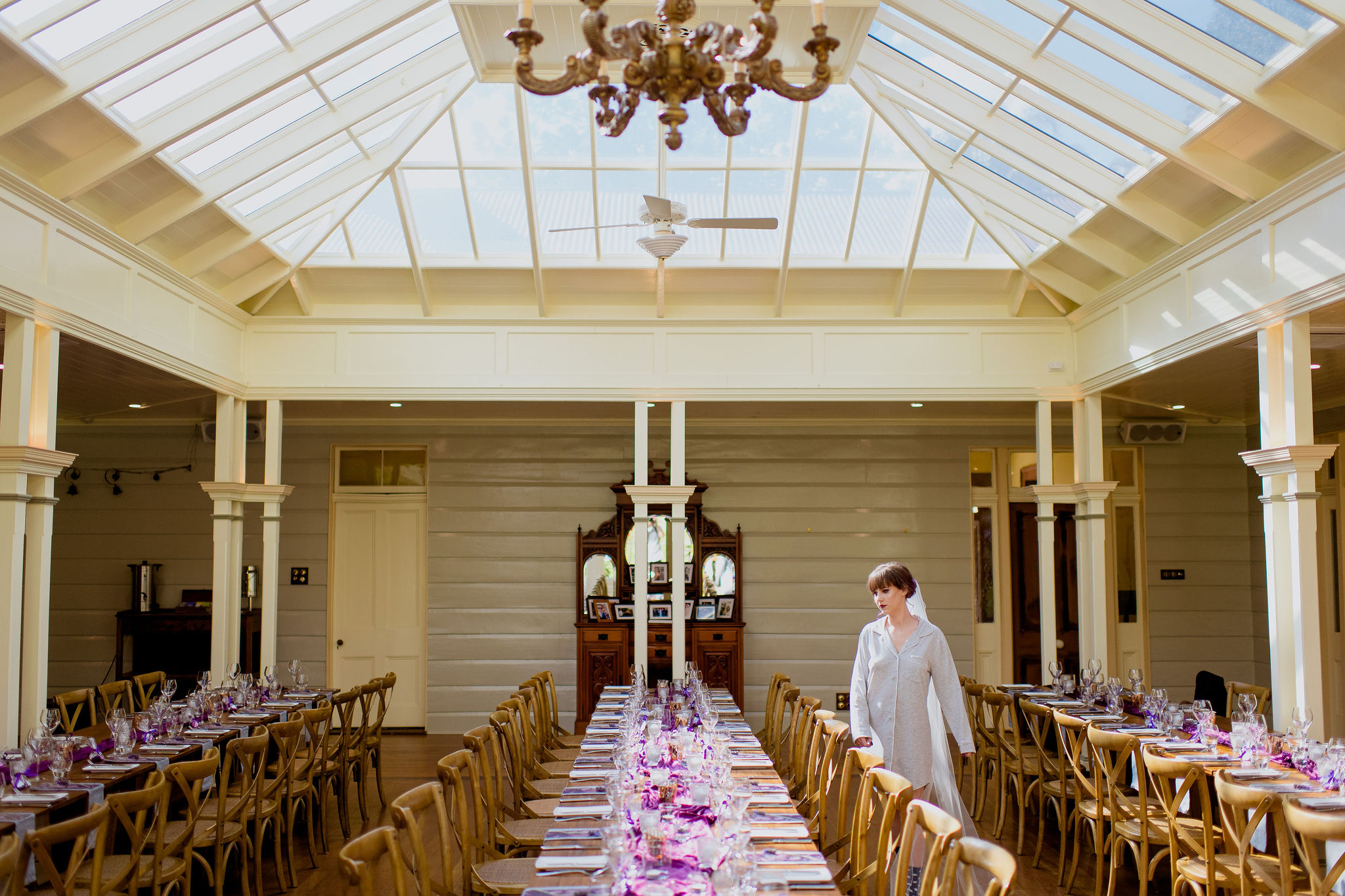 Bride-to-be examining dining hall with glass roof