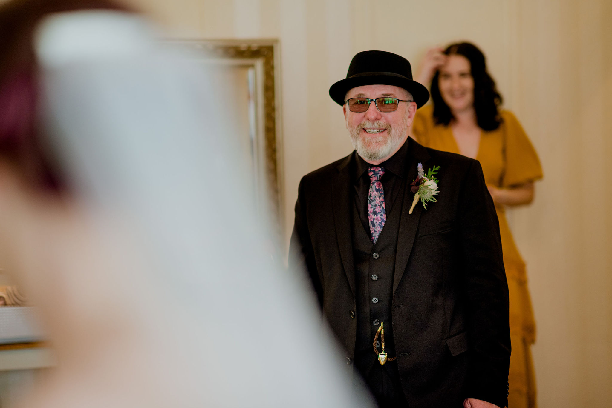 Father of the bride smiles as he sees his daughter in her dress