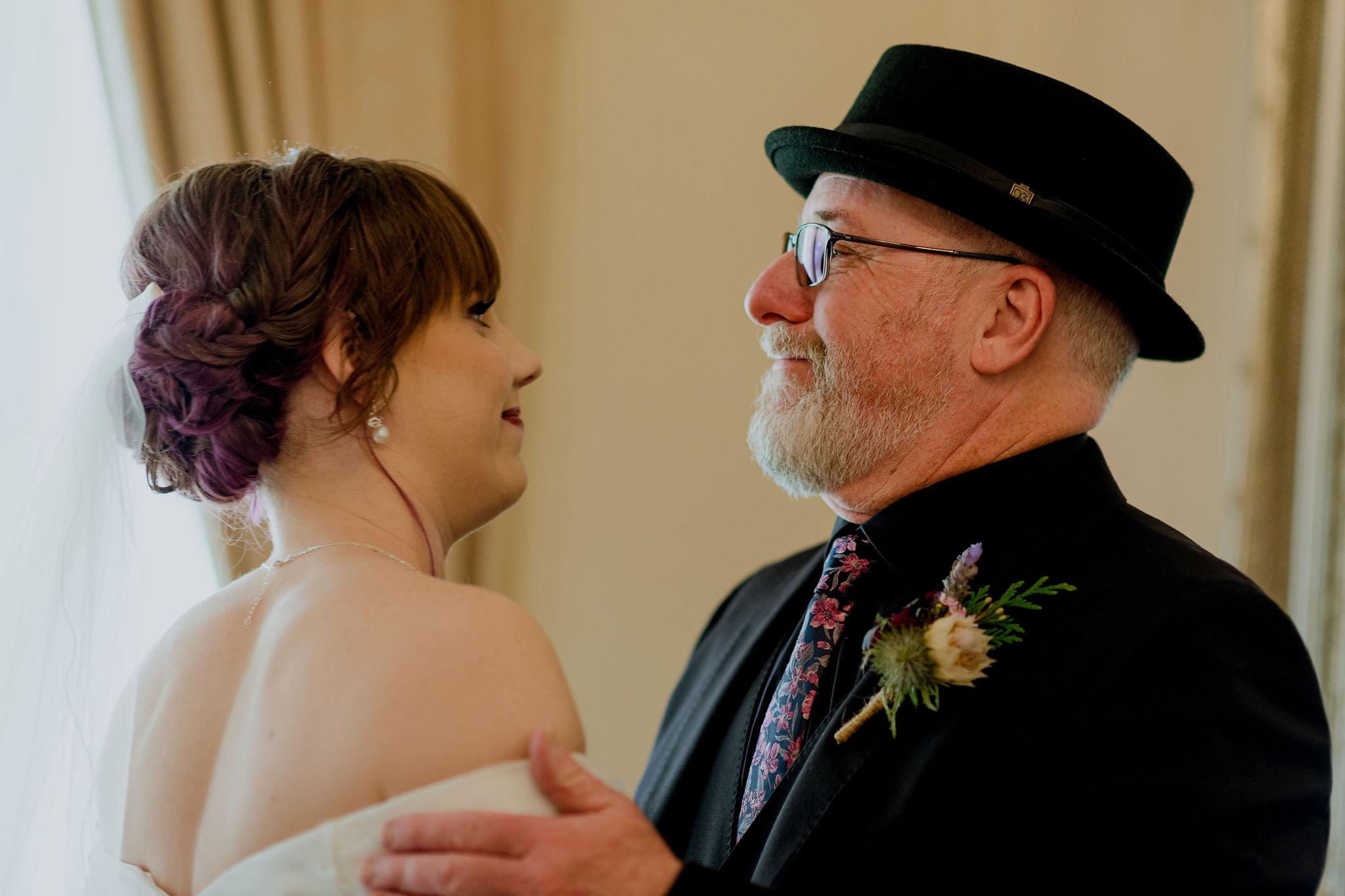 Father-of-the-bride hugs bride