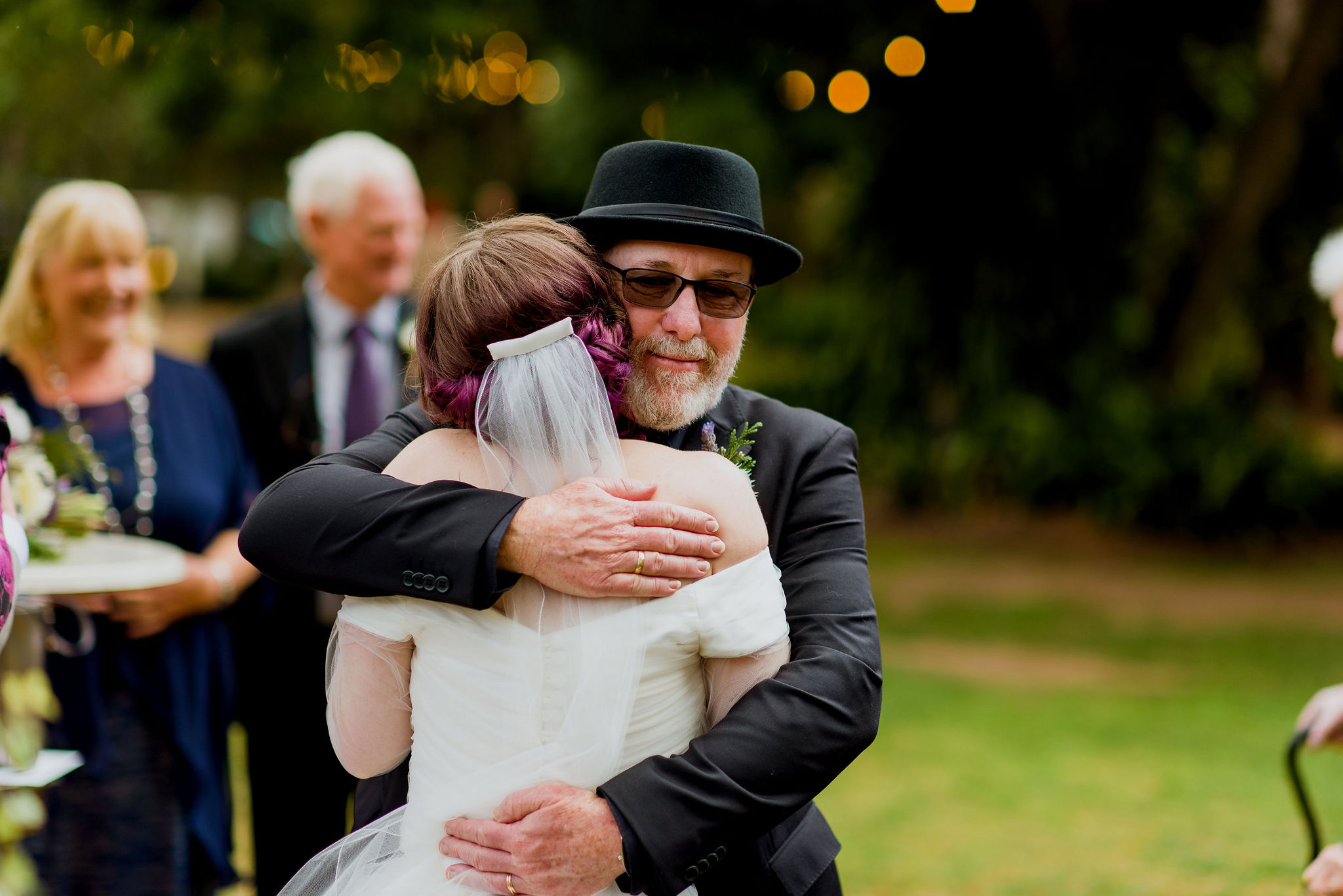 Father-of-the-bride embraces his daughter