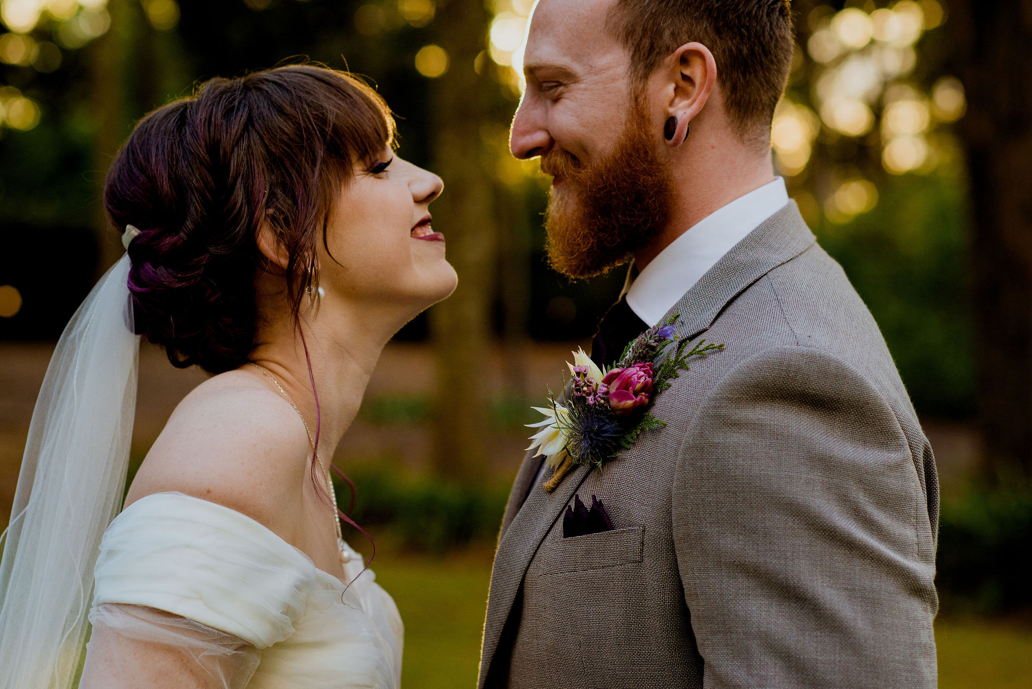 Newlywed bride and groom smile at each other