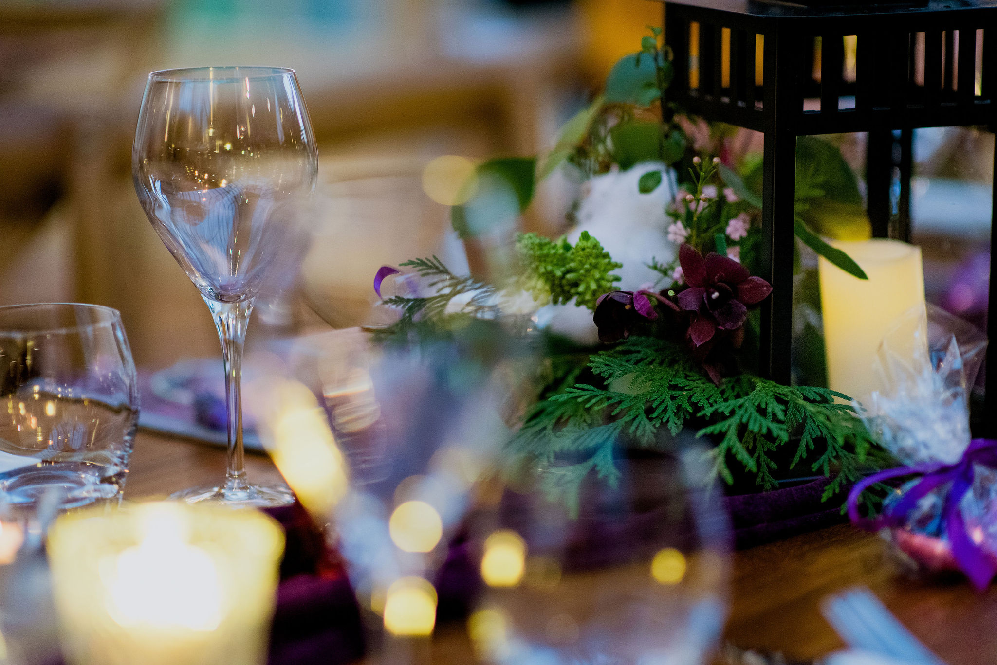 Detail shot of table setting, close up of wine glass and lantern