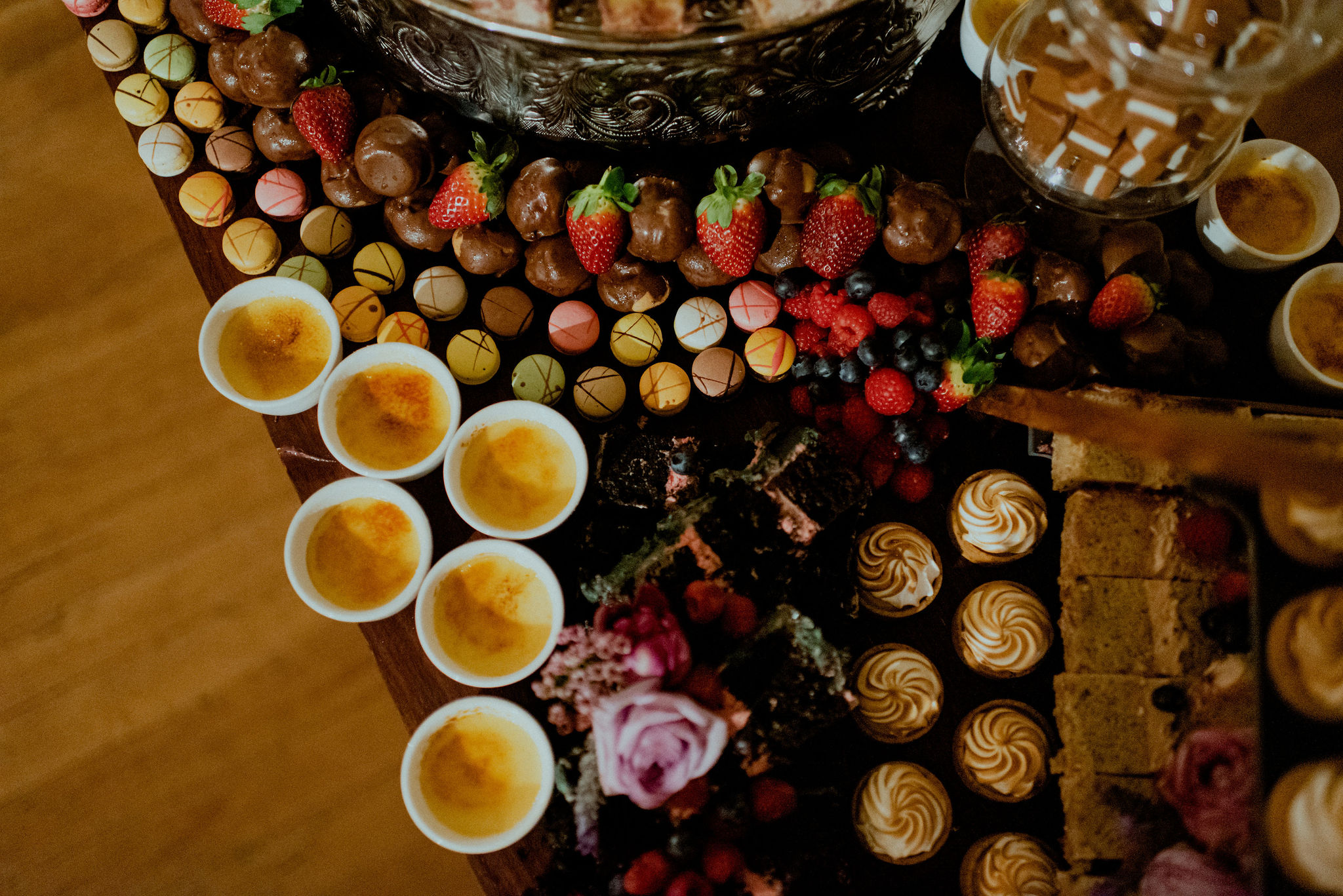 Birds-eye-view of a table with many different desserts