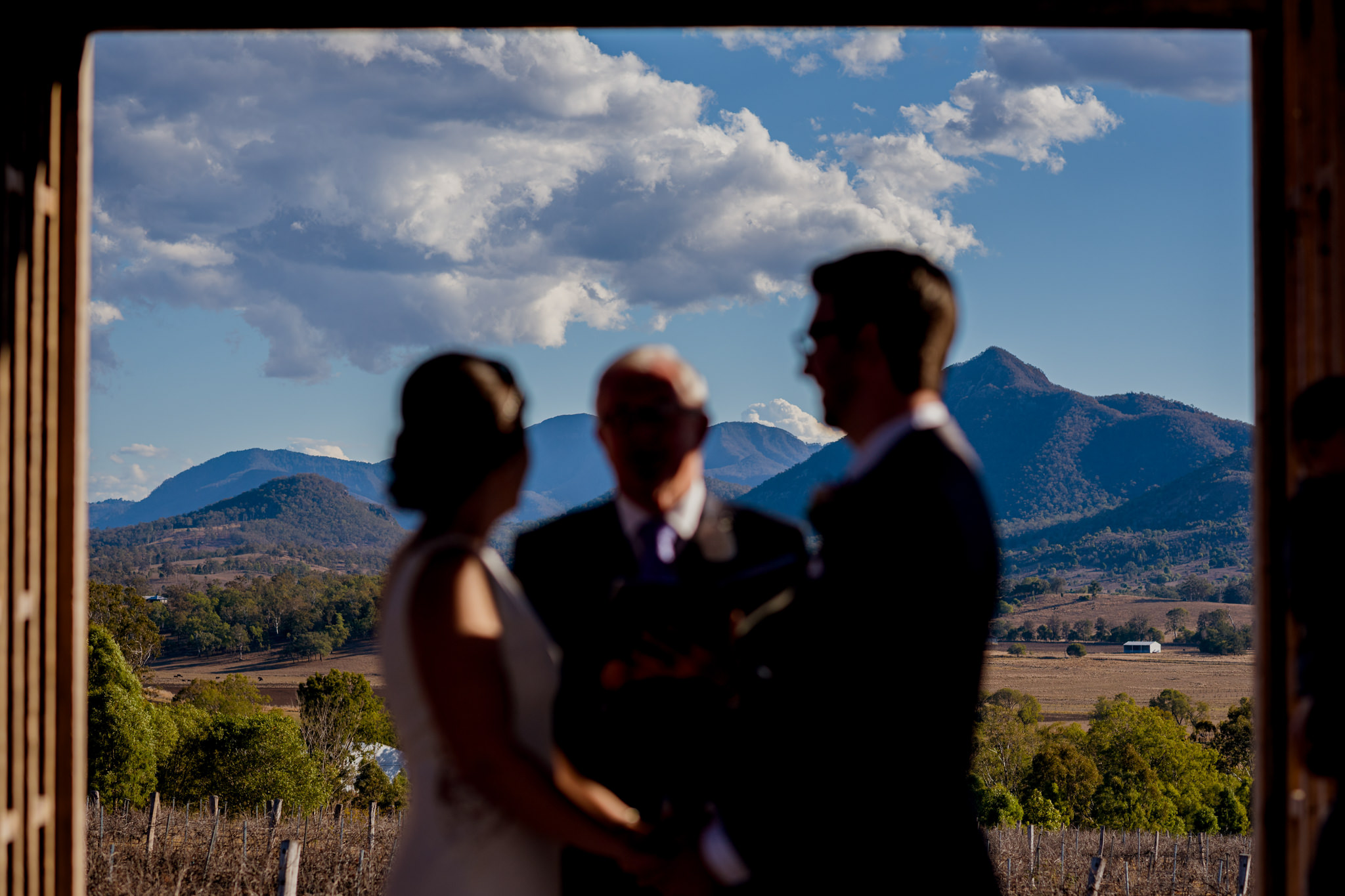 Landscape of mountain regions with blurred bride and groom in foreground