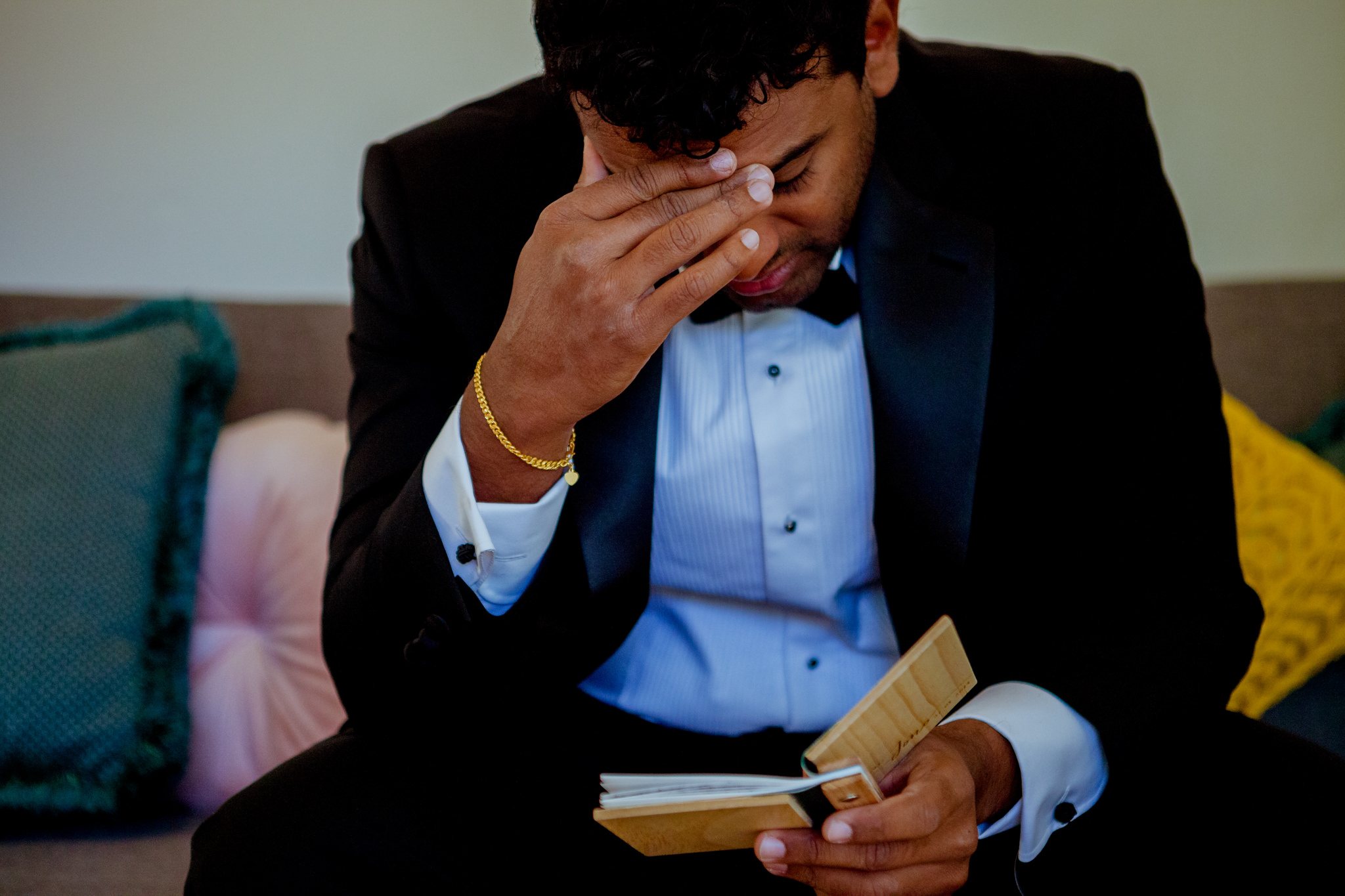 Groom cries as he reads a personalised wooden booklet