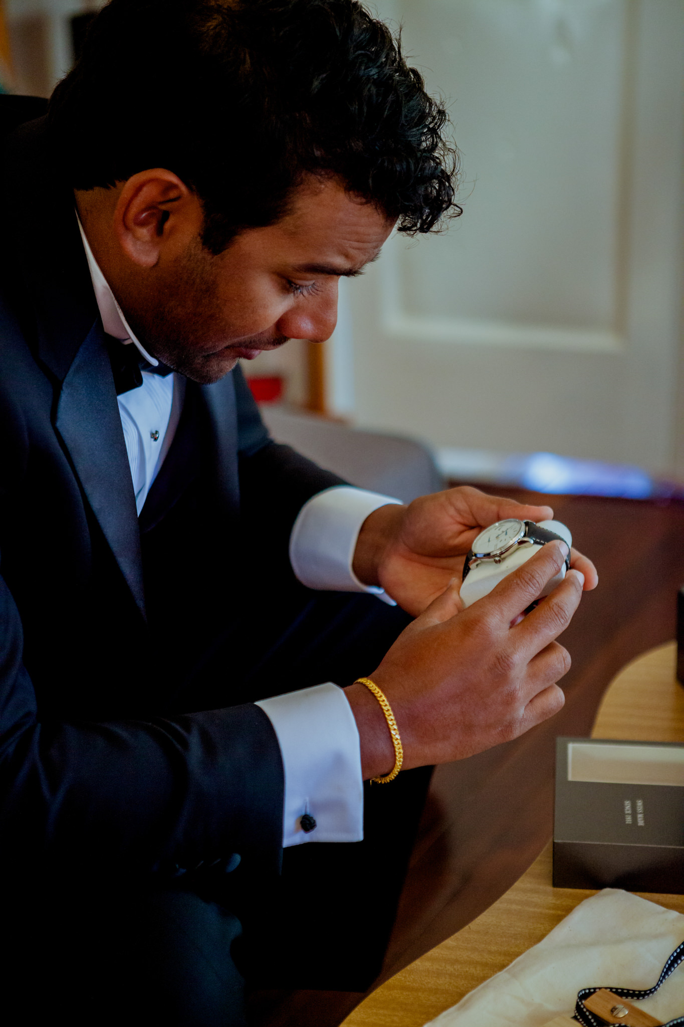 Groom cries as he admires a new watch given as a wedding gift