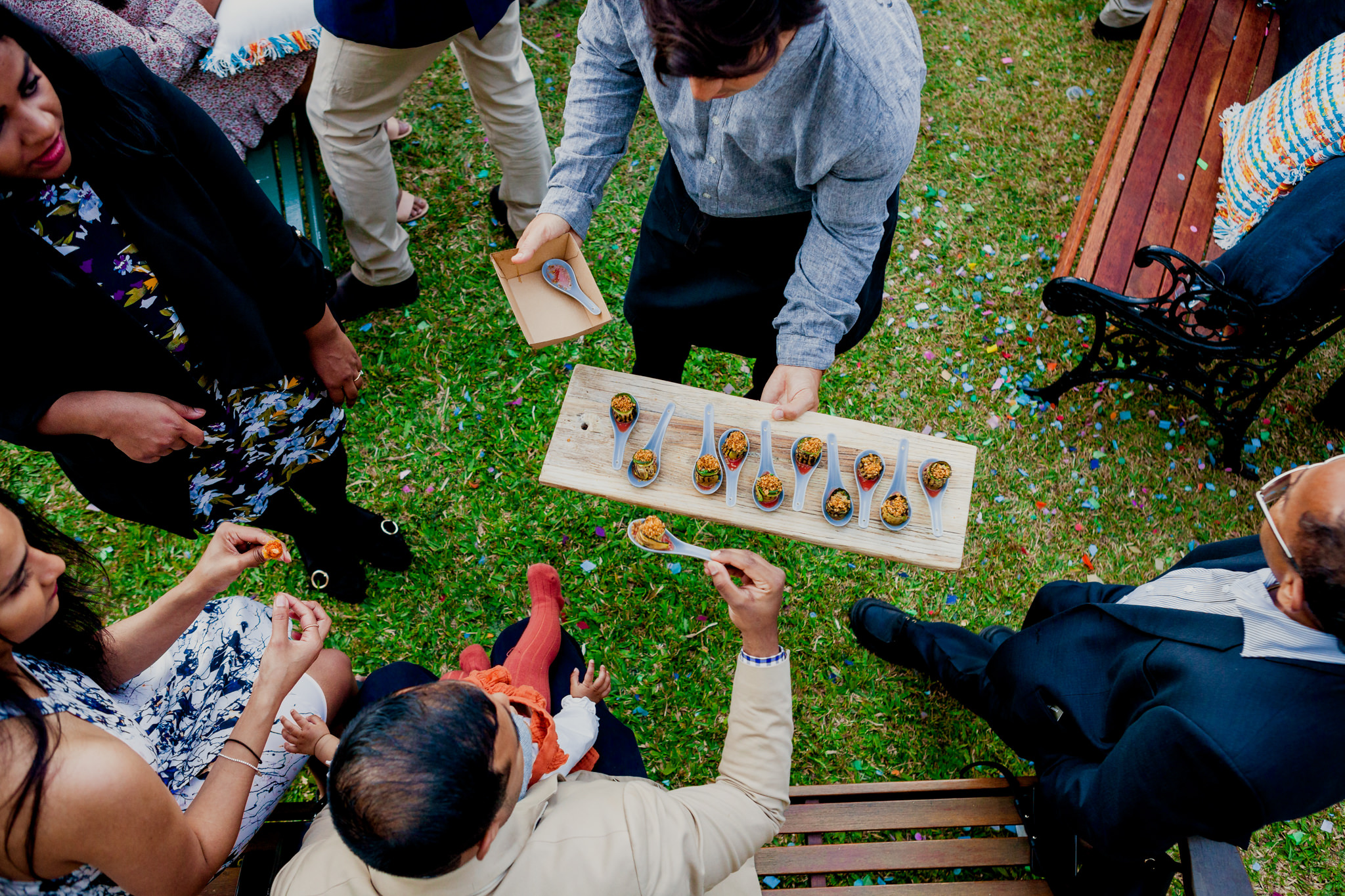 Aerial view of caterer serving guests canapes on a lawn