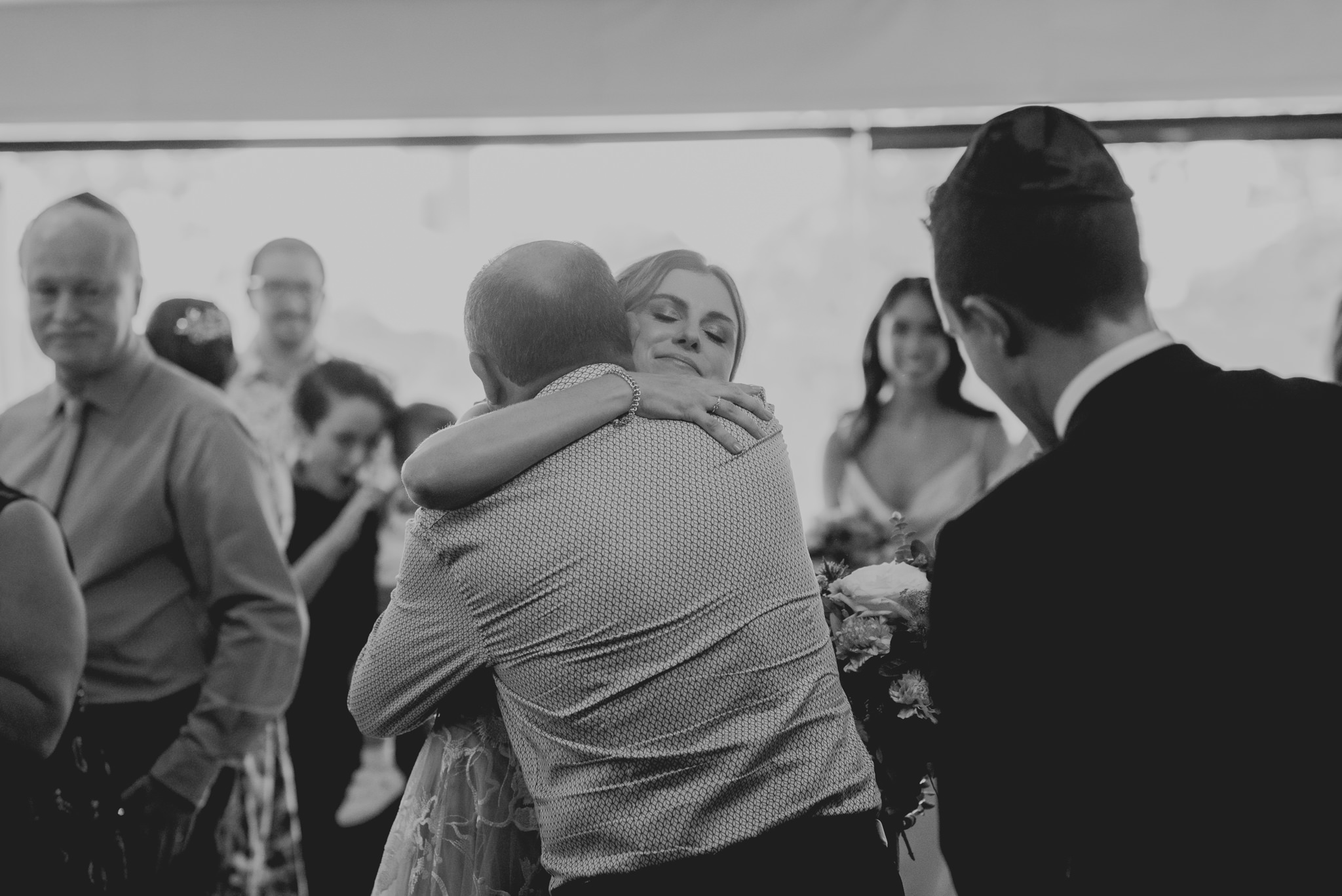 Bride hugs her father emotionally at the beginning of her wedding ceremony