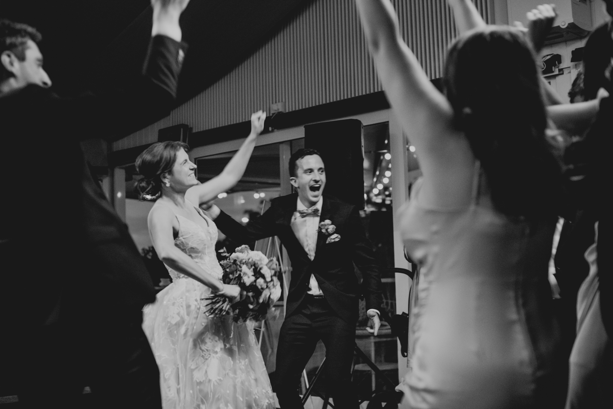 Bride and groom yelling and dancing excitedly