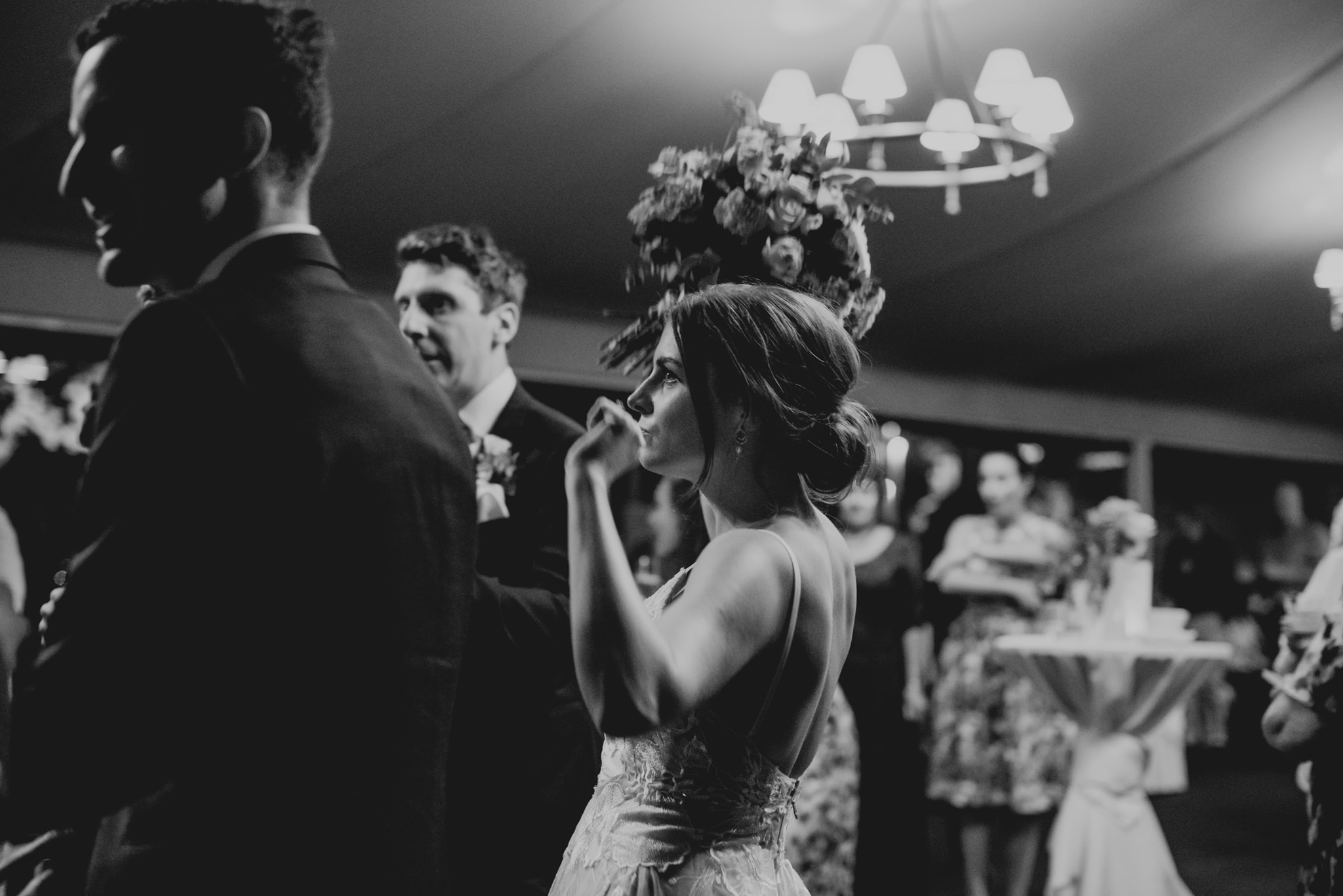 Bride dancing with bouquet in one hand