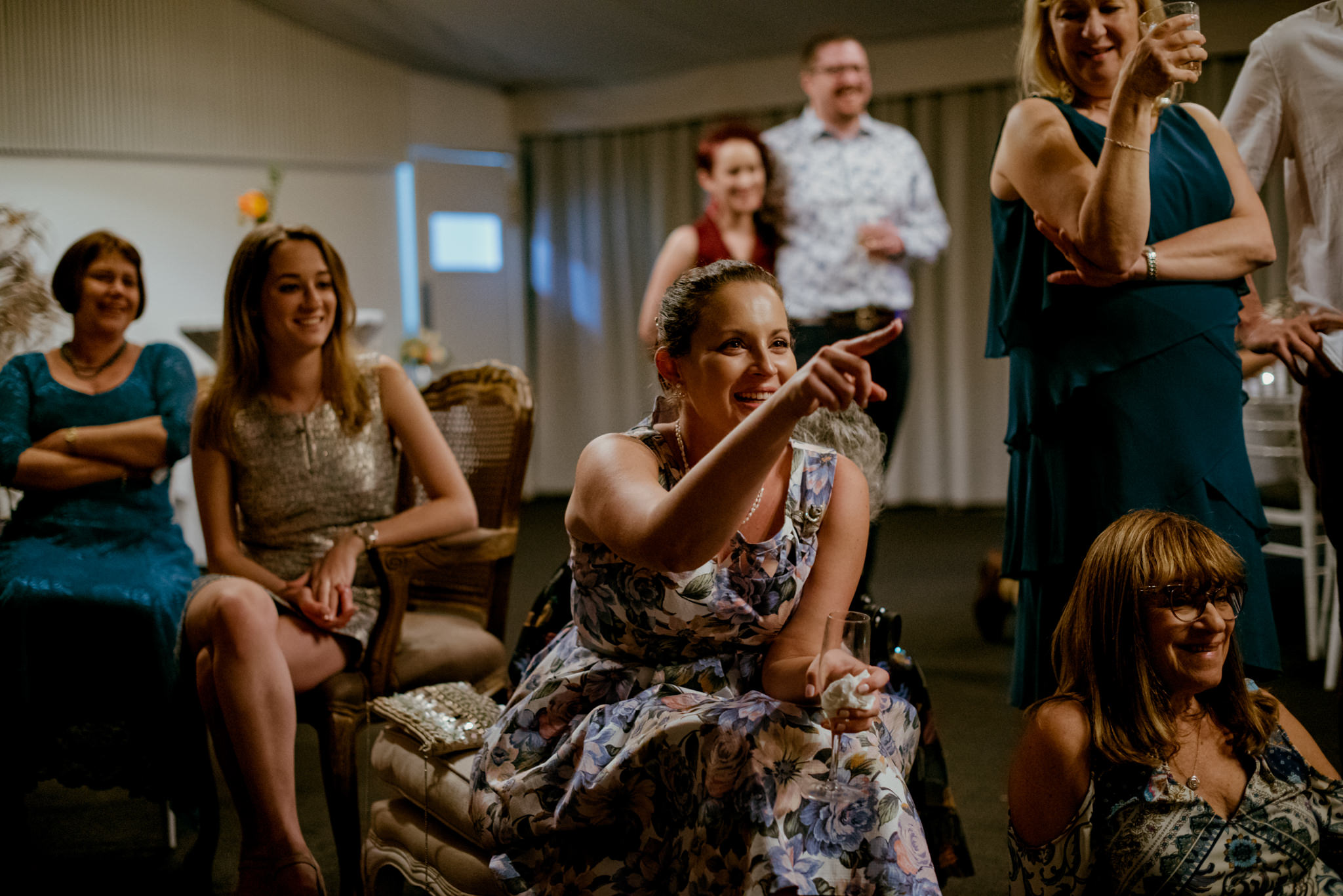 Wedding guest points and laughs