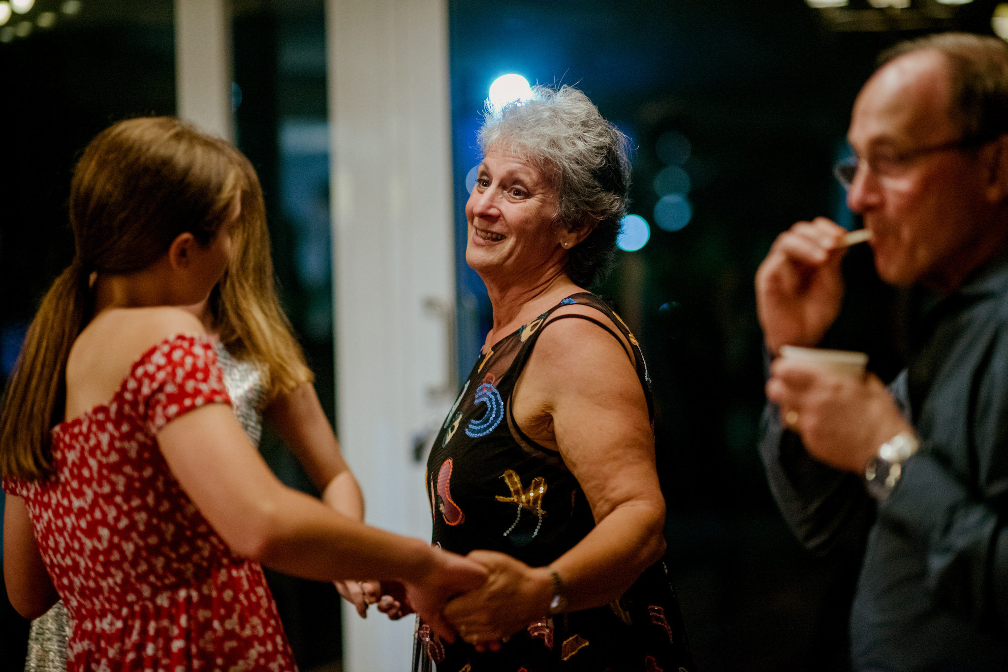 Guests dance at a wedding
