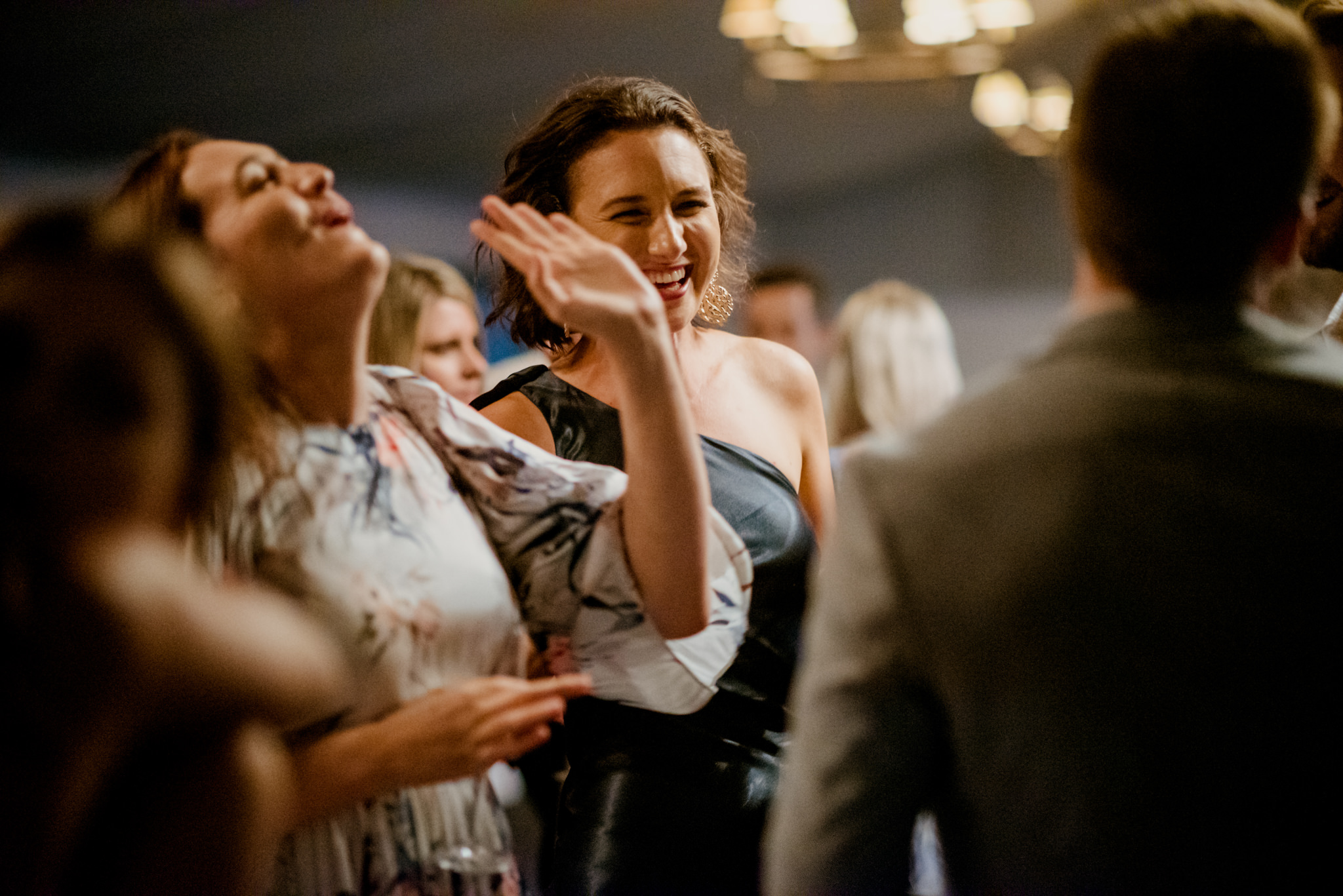 Woman laughing dancing with other people