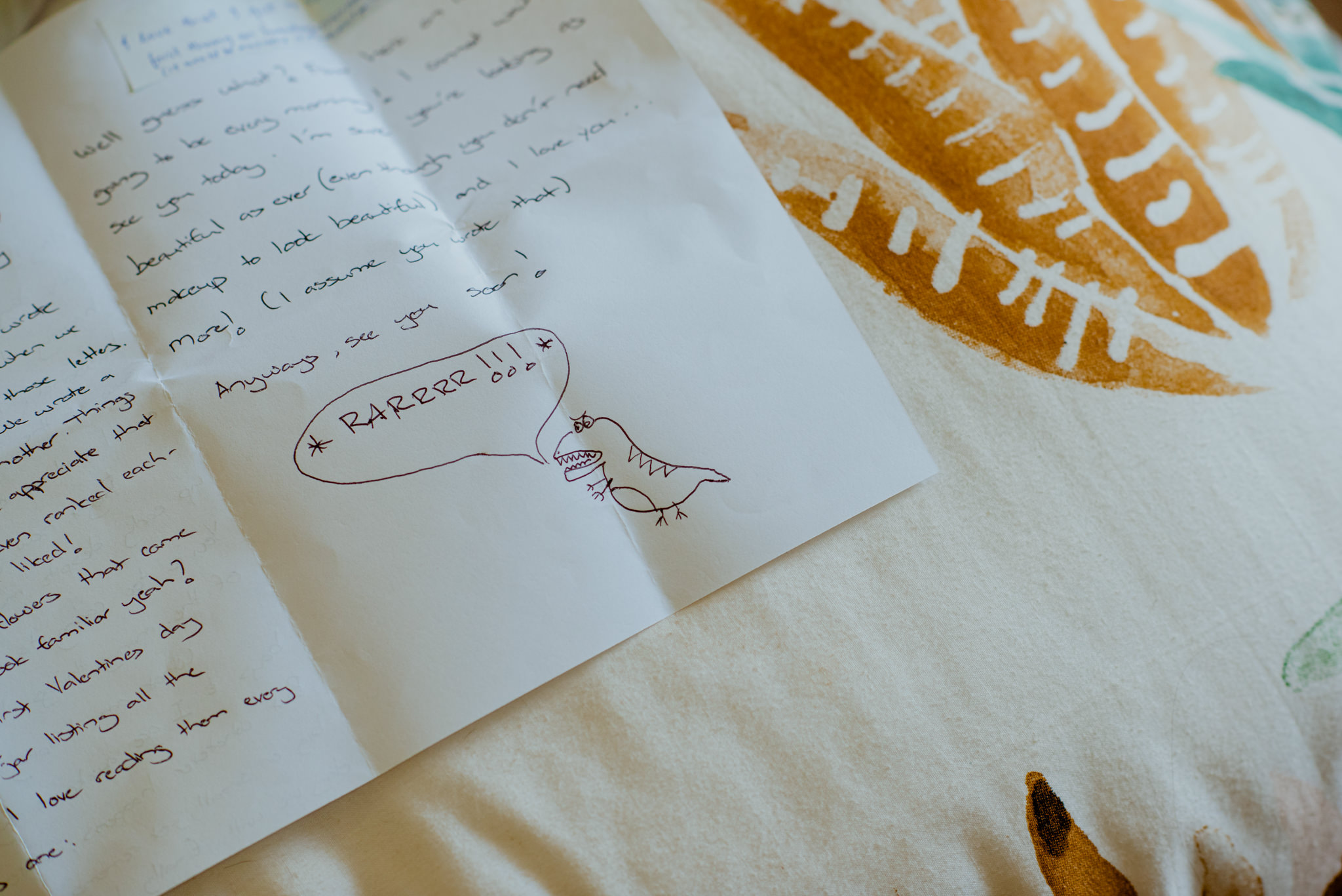 A comic drawing of a dinosaur on a hand-written note