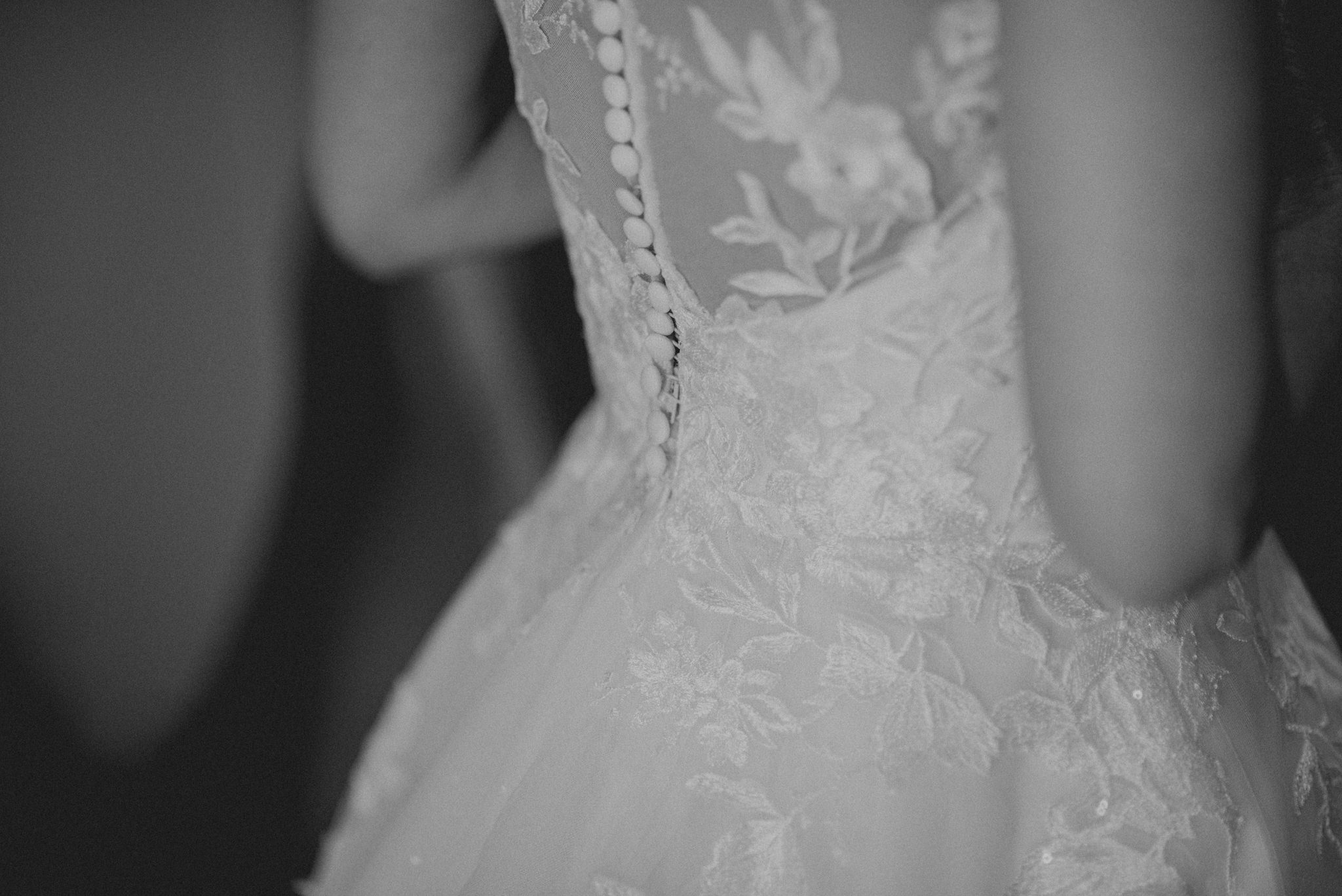 The back of a wedding dress worn by a woman