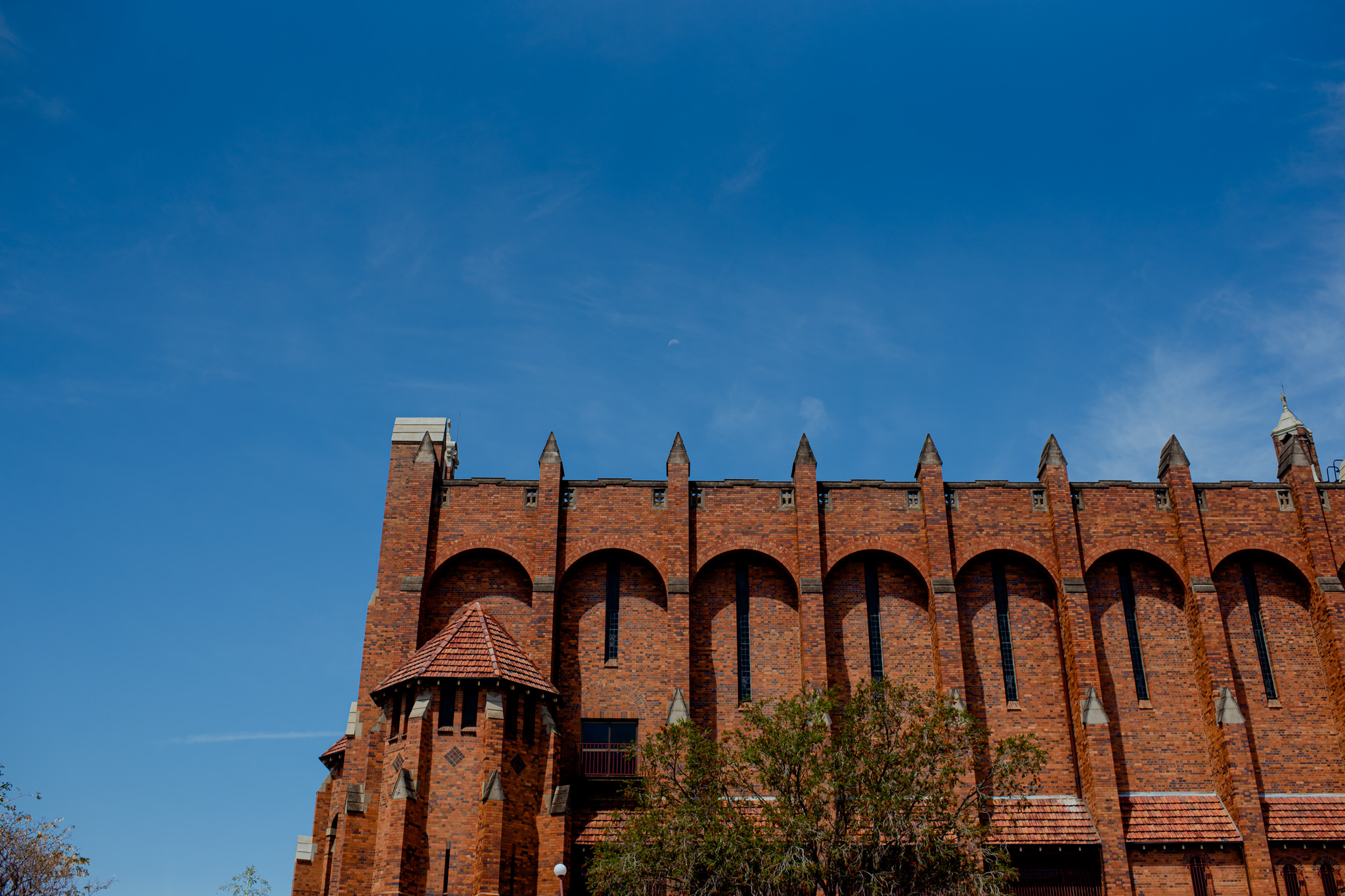 The roof of a red brick cathedral in Brisbane