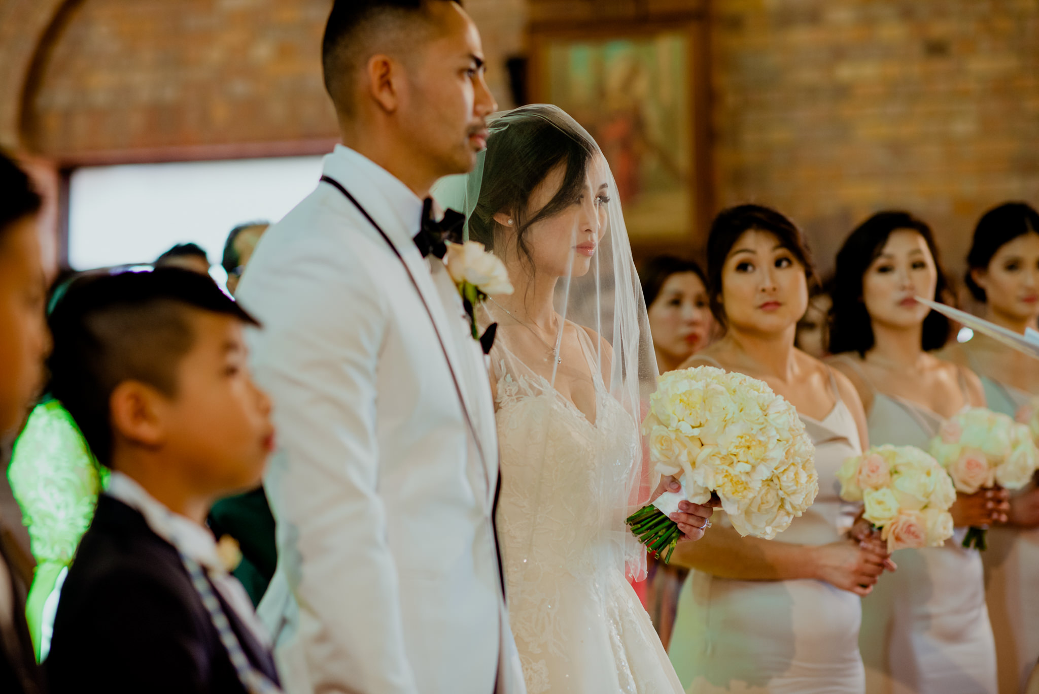 Bride and groom stand during their wedding ceremony