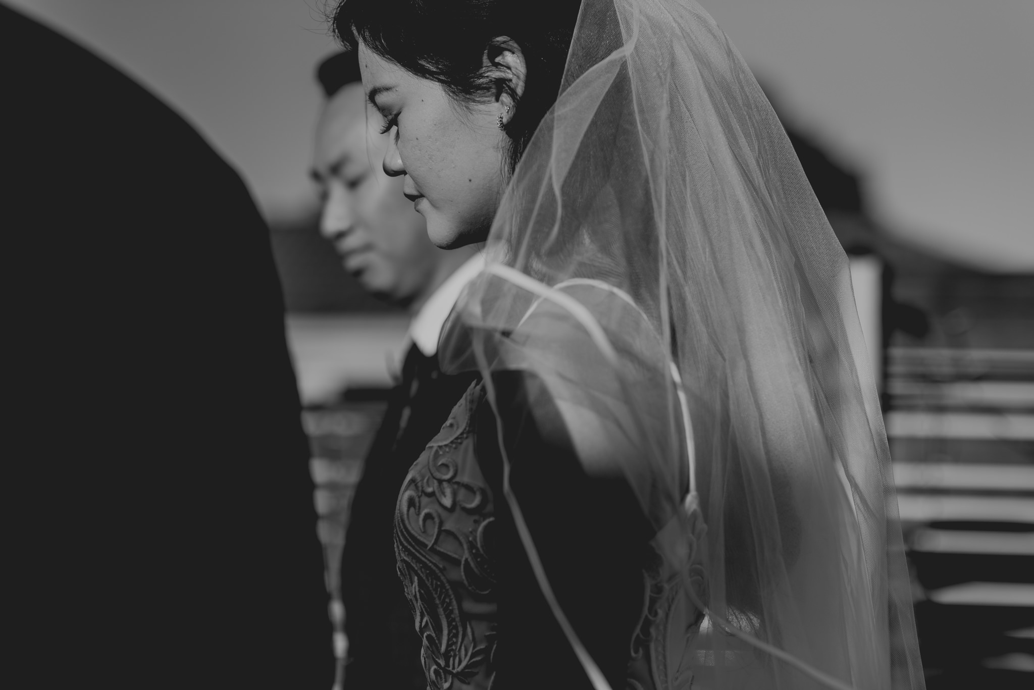 Portrait of a bride closing her eyes during a wedding ceremony