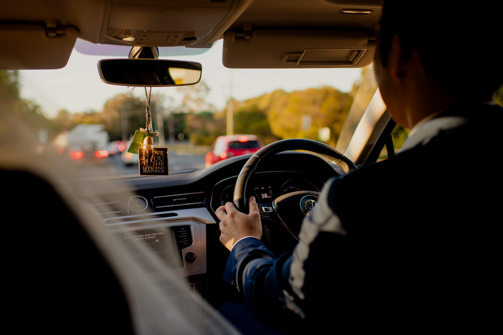 A man driving a car in the afternoon